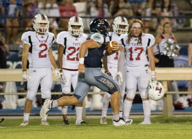 Tyler Dittmer (36) with a big pick up during the Tate vs Gulf Breeze football game at Gulf Breeze High School in Pace on Friday, August 31, 2018.