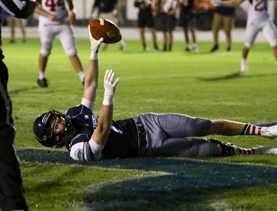 Spencer Segal scores one of his three touchdowns Friday night for Gulf Breeze in first game back from devastating injury.
