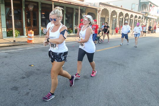 Hundreds of people make their way through downtown Pensacola during the 35th annual Semper Fi 5K run, presented by the Marine Corps League and TEL Staffing & HR, on Saturday, September 8, 2018. The event raises money for multiple local charities.
