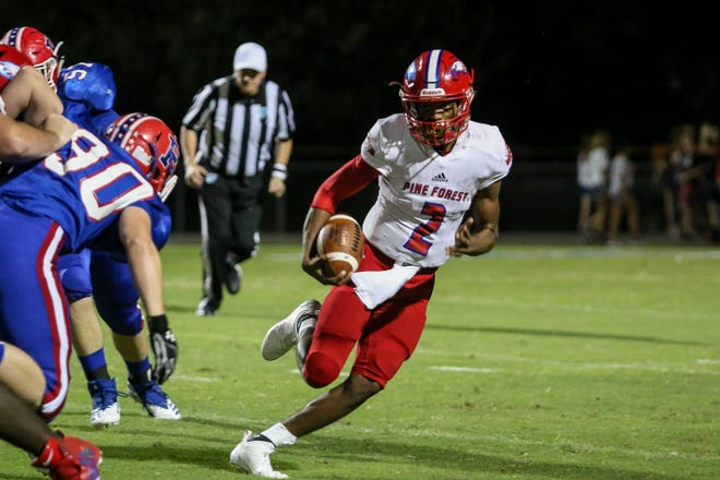 Pine Forest quarterback Ladarius Clardy (2) keeps the ball and runs up the field against the Patriots at Pace High School on Friday, September 7, 2018.