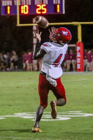 Pine Forest's Vontarious Hill (4) comes down with an over-the-shoulder catch that resulted in a 75-yard touchdown against the Patriots at Pace High School on Friday, September 7, 2018.
