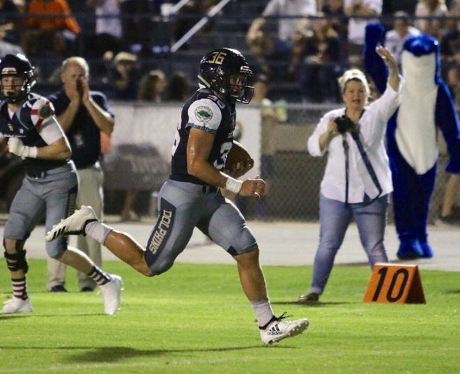 Gulf Breeze star running back Tyler Dittmer scores one of his five touchdowns in rout against Tate Aggies