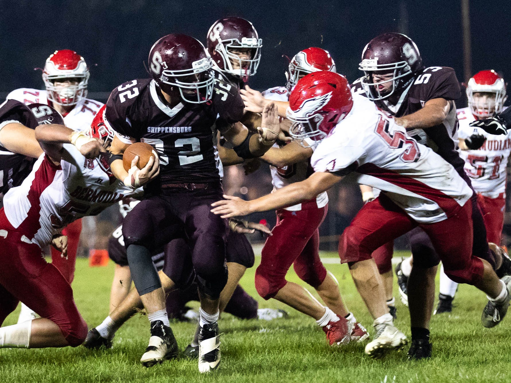 Shippensburg's Nick Weltz (32) attempts to get past the Bermudian Springs defense during a football game between Shippensburg and Bermudian Springs, Friday, Sept. 7, 2018, at Shippensburg High School. The Shippensburg Greyhounds defeated the Bermudian Springs Eagles 31-17.