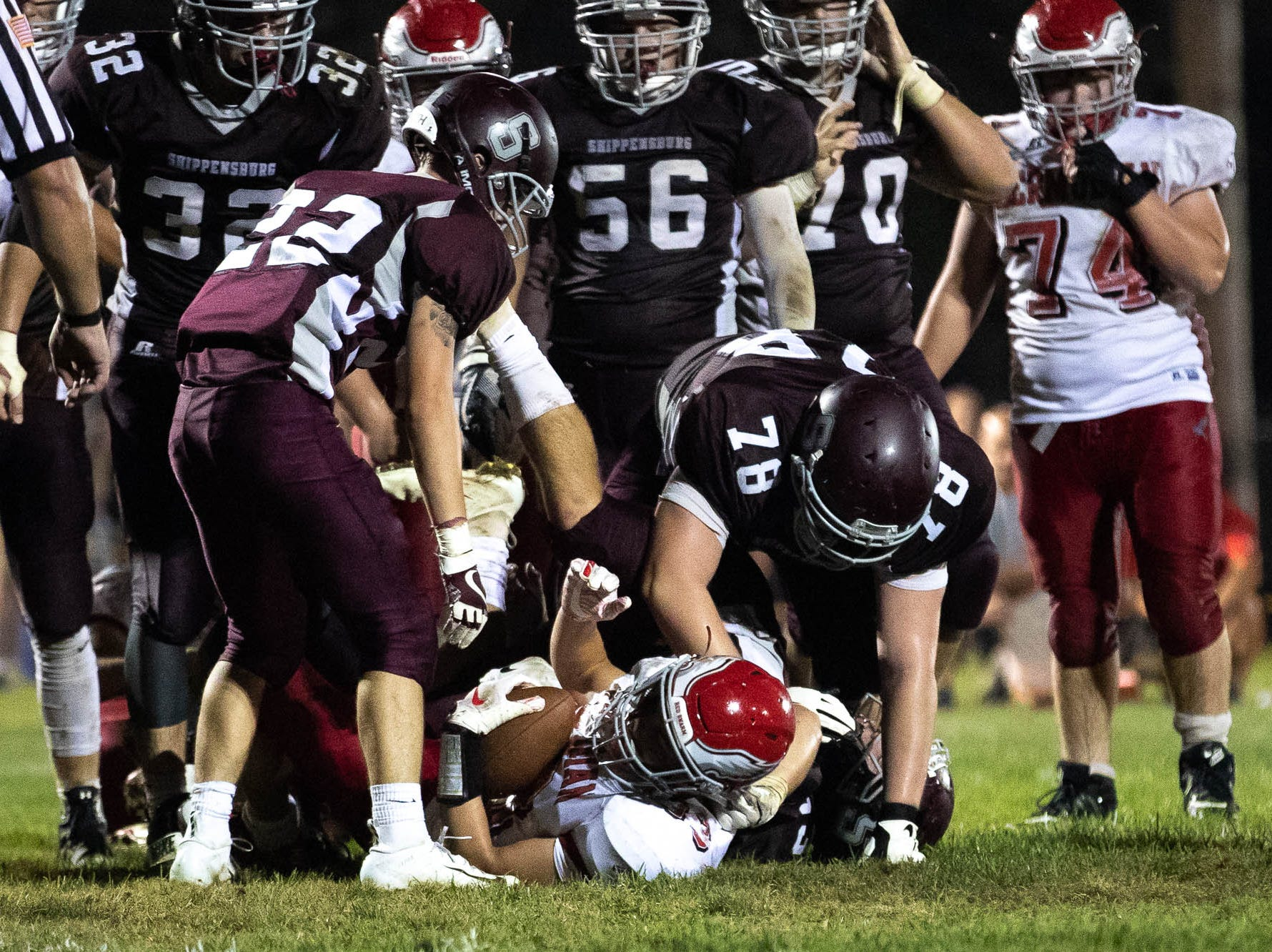 Bermudian Springs' Trace Grim (33) is piled on by the Shippensburg defense during a football game between Shippensburg and Bermudian Springs, Friday, Sept. 7, 2018, at Shippensburg High School. The Shippensburg Greyhounds defeated the Bermudian Springs Eagles 31-17.