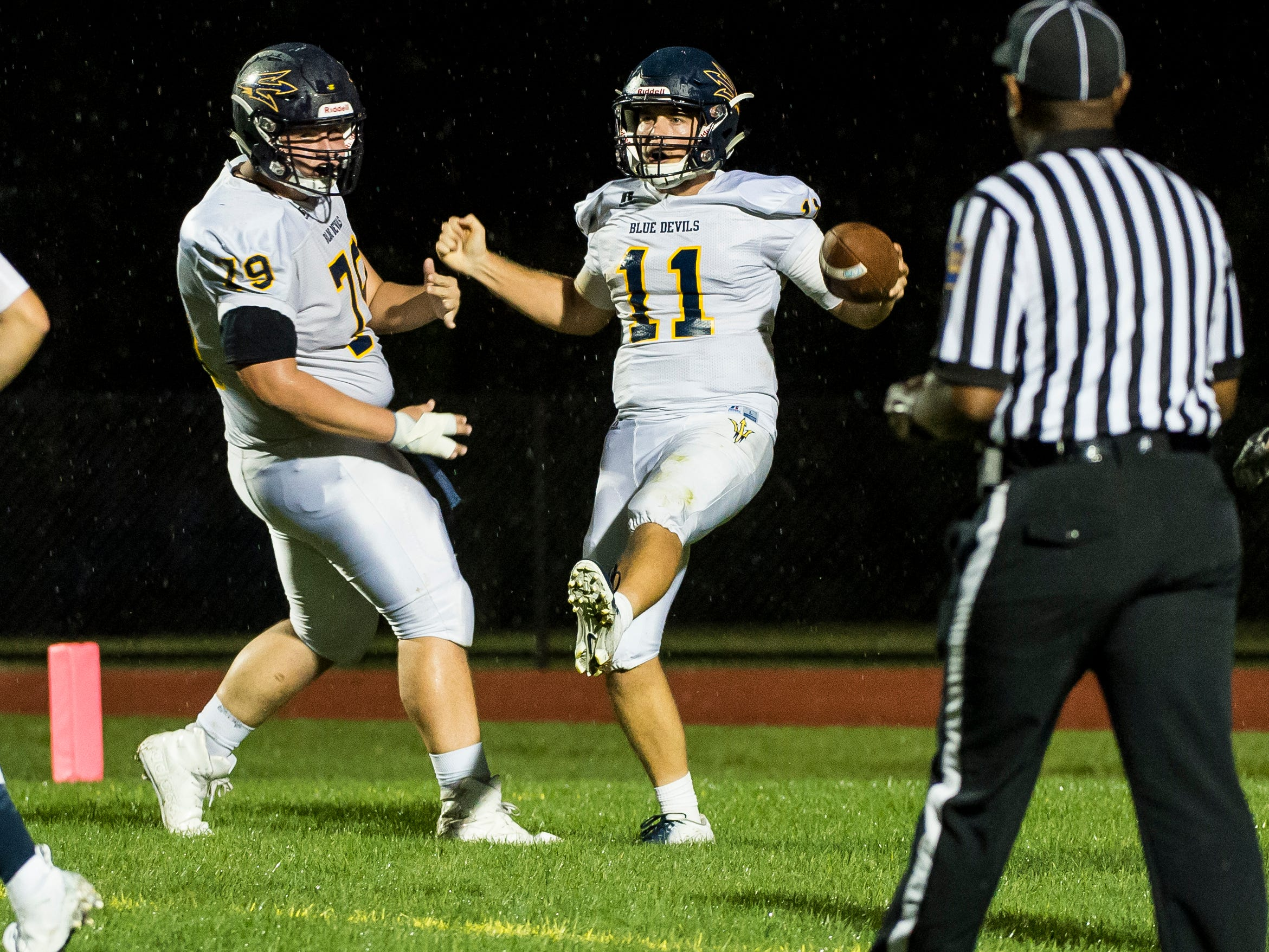Greencastle-Antrim's Max McDowell (11) celebrates a touchdown during play against Hanover on Friday, September 7, 2018.