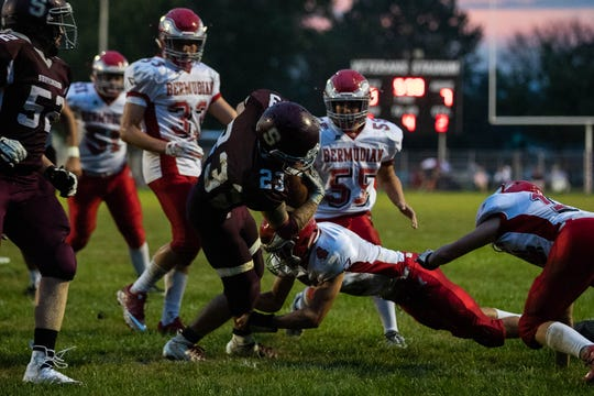 Shippensburg's Kyler Brown (23) is tackled into the end zone for a touchdown during a football game between Shippensburg and Bermudian Springs, Friday, Sept. 7, 2018, at Shippensburg High School.