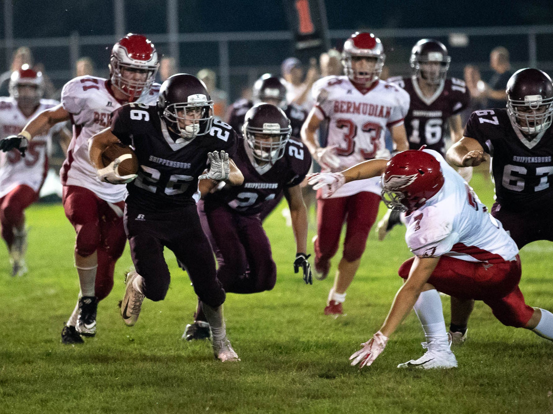 Shippensburg's Alex Sharrow (26) attempts to outrun the Bermudian defense during a football game between Shippensburg and Bermudian Springs, Friday, Sept. 7, 2018, at Shippensburg High School. The Shippensburg Greyhounds defeated the Bermudian Springs Eagles 31-17.