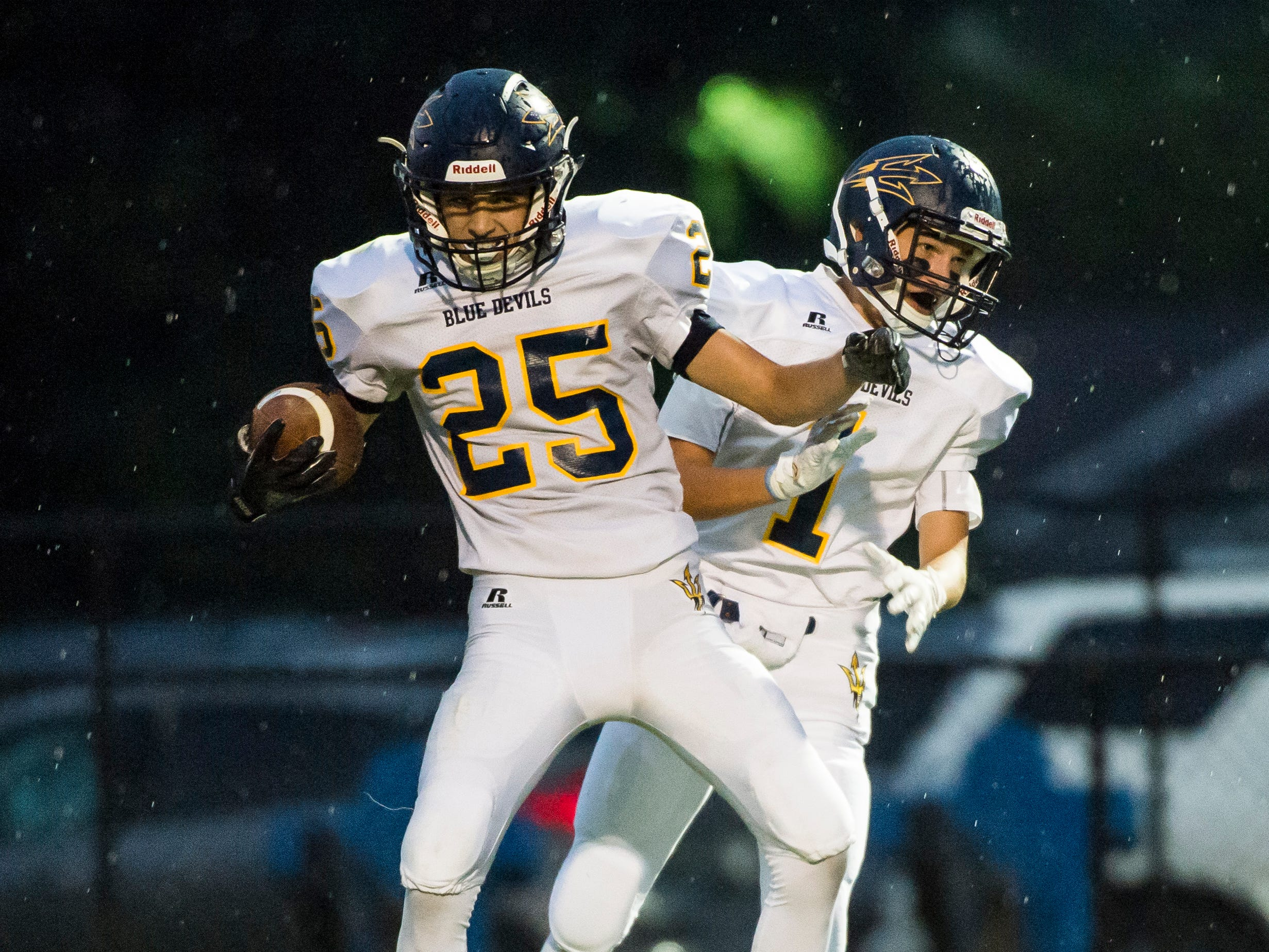 Greencastle-Antrim's Ethan Murr (25) celebrates with Malachi Rhodes after scoring a touchdown against Hanover on Friday, September 7, 2018.