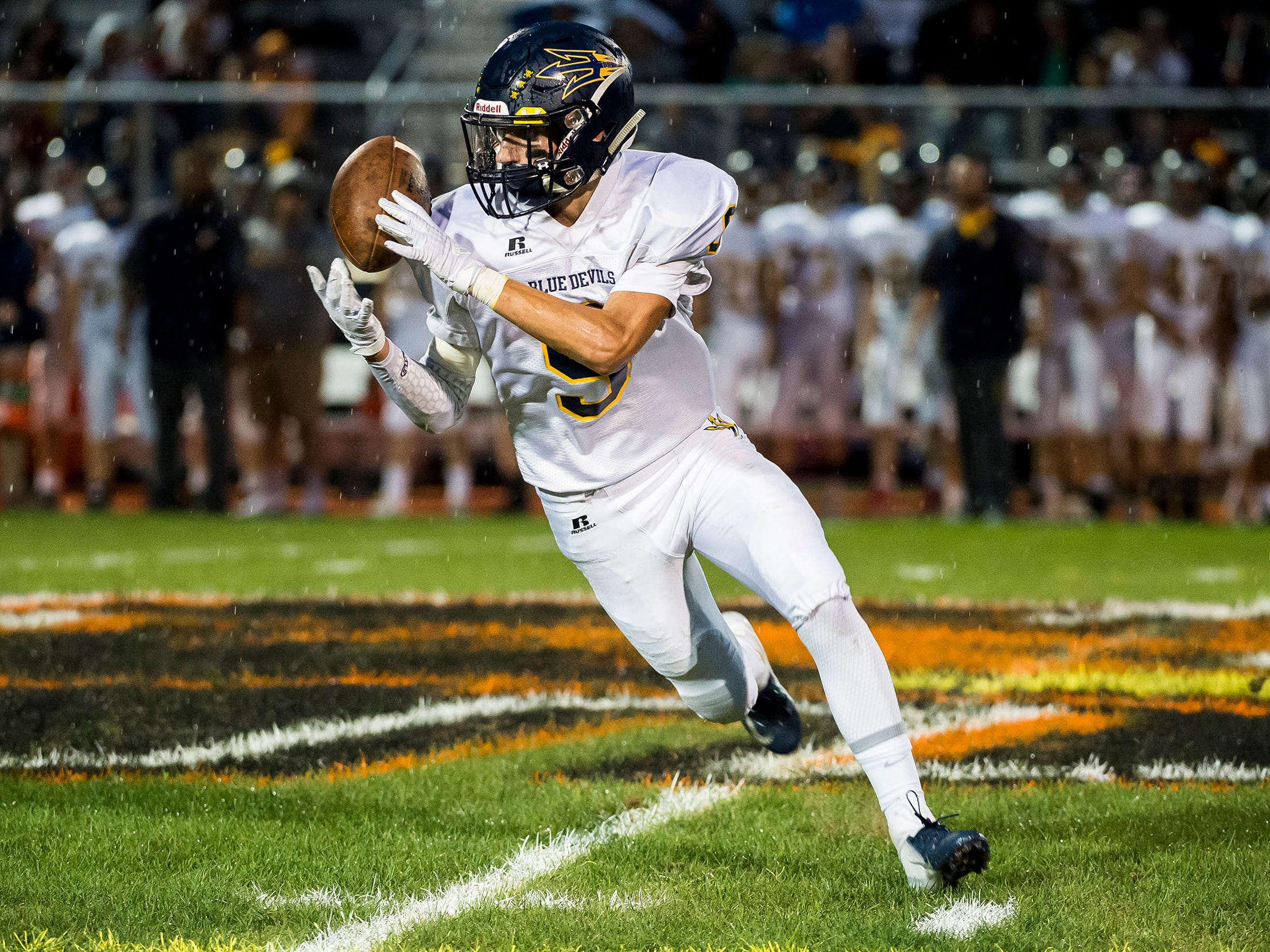 Greencastle-Antrim's Gunnar Valentine bobbles the ball during a kick return against Hanover on Friday, September 7, 2018.