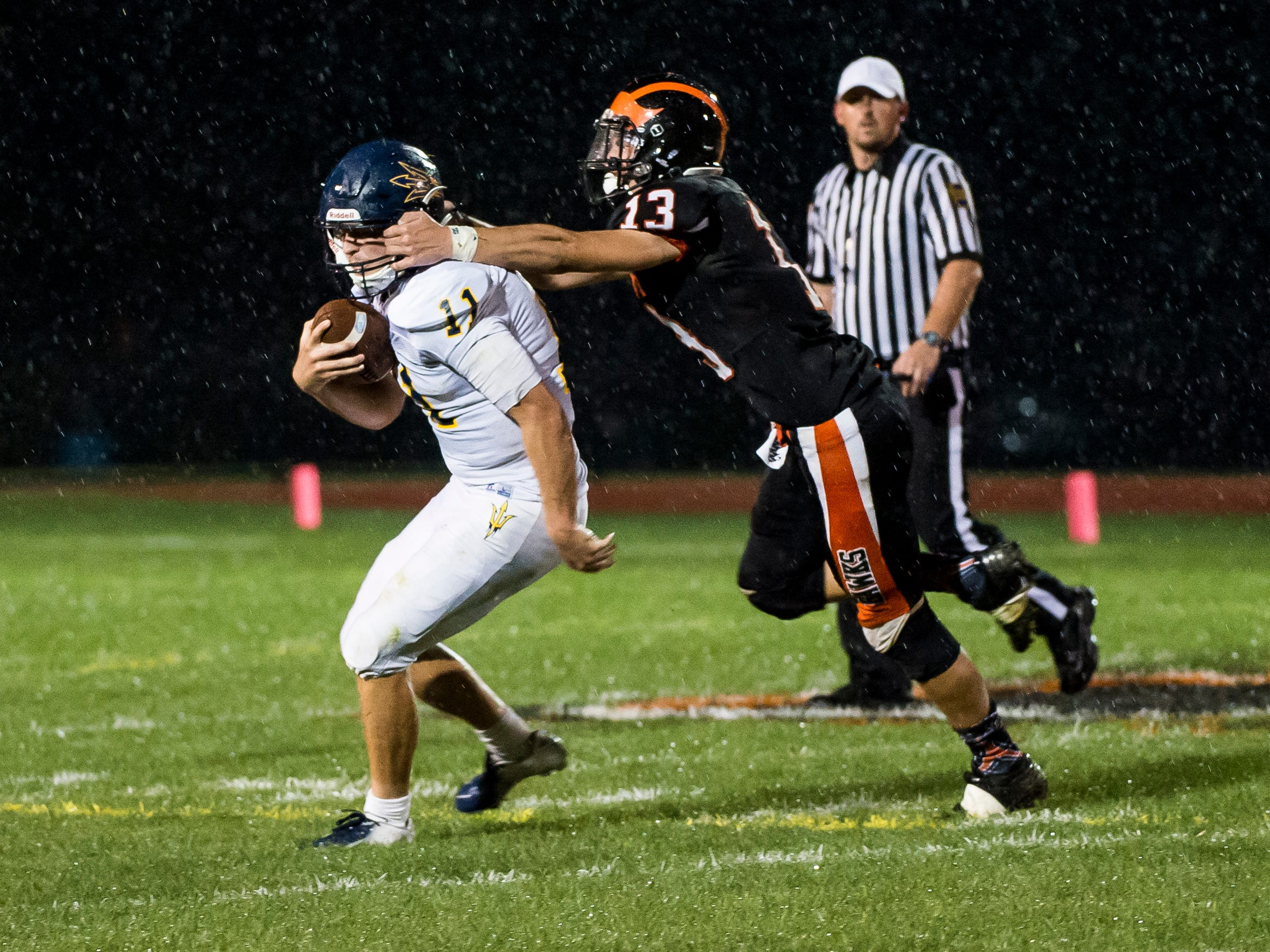 Hanover's Josh Postell tackles Greencastle Antrim's Max McDowell in the backfield during a game on Friday, September 7, 2018.
