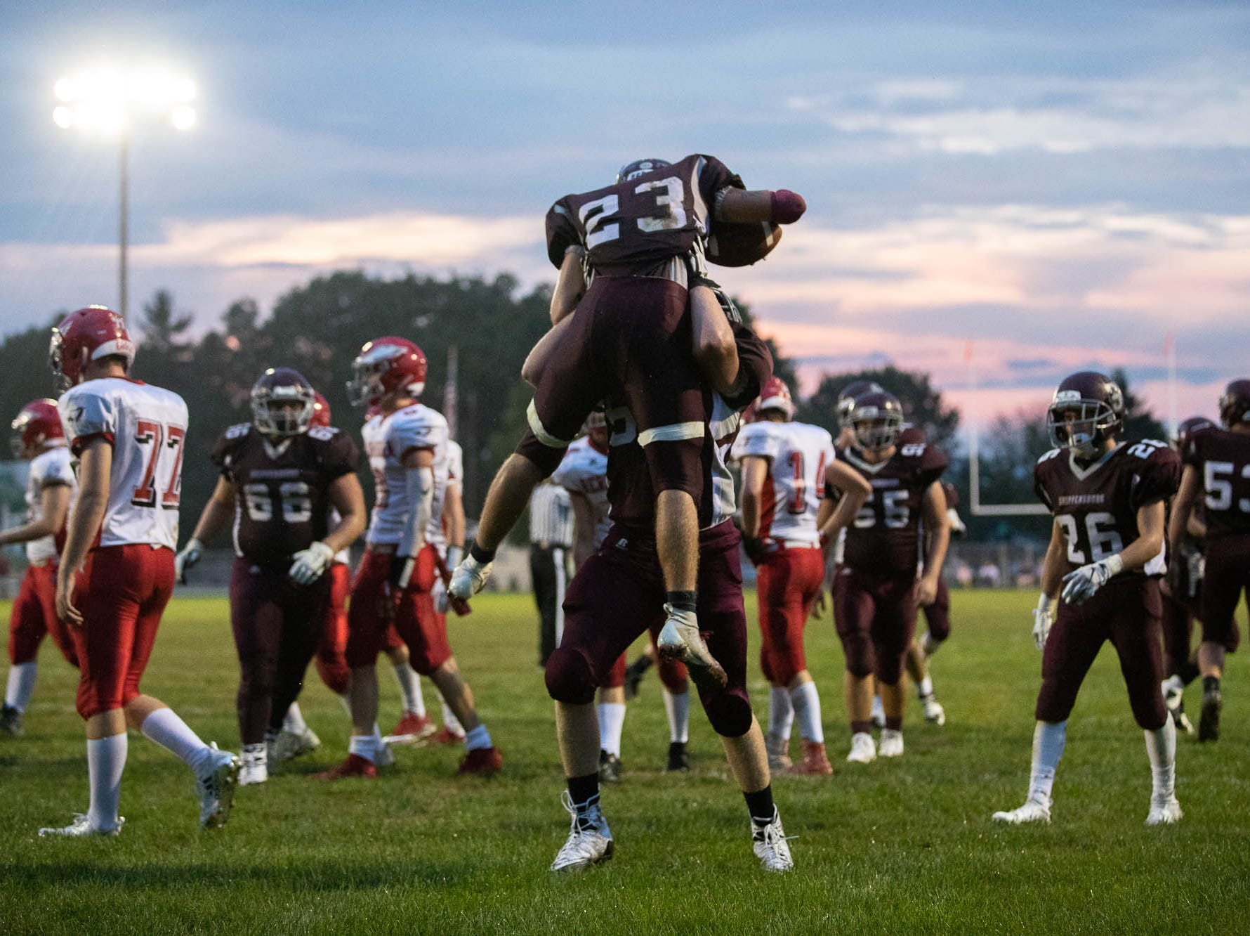 Shippensburg's Kyler Brown (23) is lifted into the air by Shippensburg's Wyatt Craig (52) after Brown scored a touchdown during a football game between Shippensburg and Bermudian Springs, Friday, Sept. 7, 2018, at Shippensburg High School.