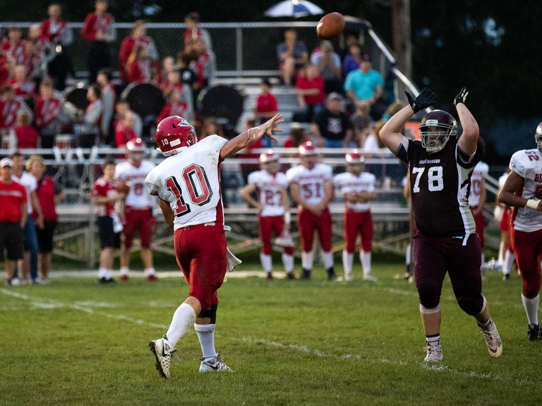 Bermudian Springs' Chase Dull (10) passes over the head of Shippensburg's Kyler Danzberger (78) during a football game between Shippensburg and Bermudian Springs, Friday, Sept. 7, 2018, at Shippensburg High School.