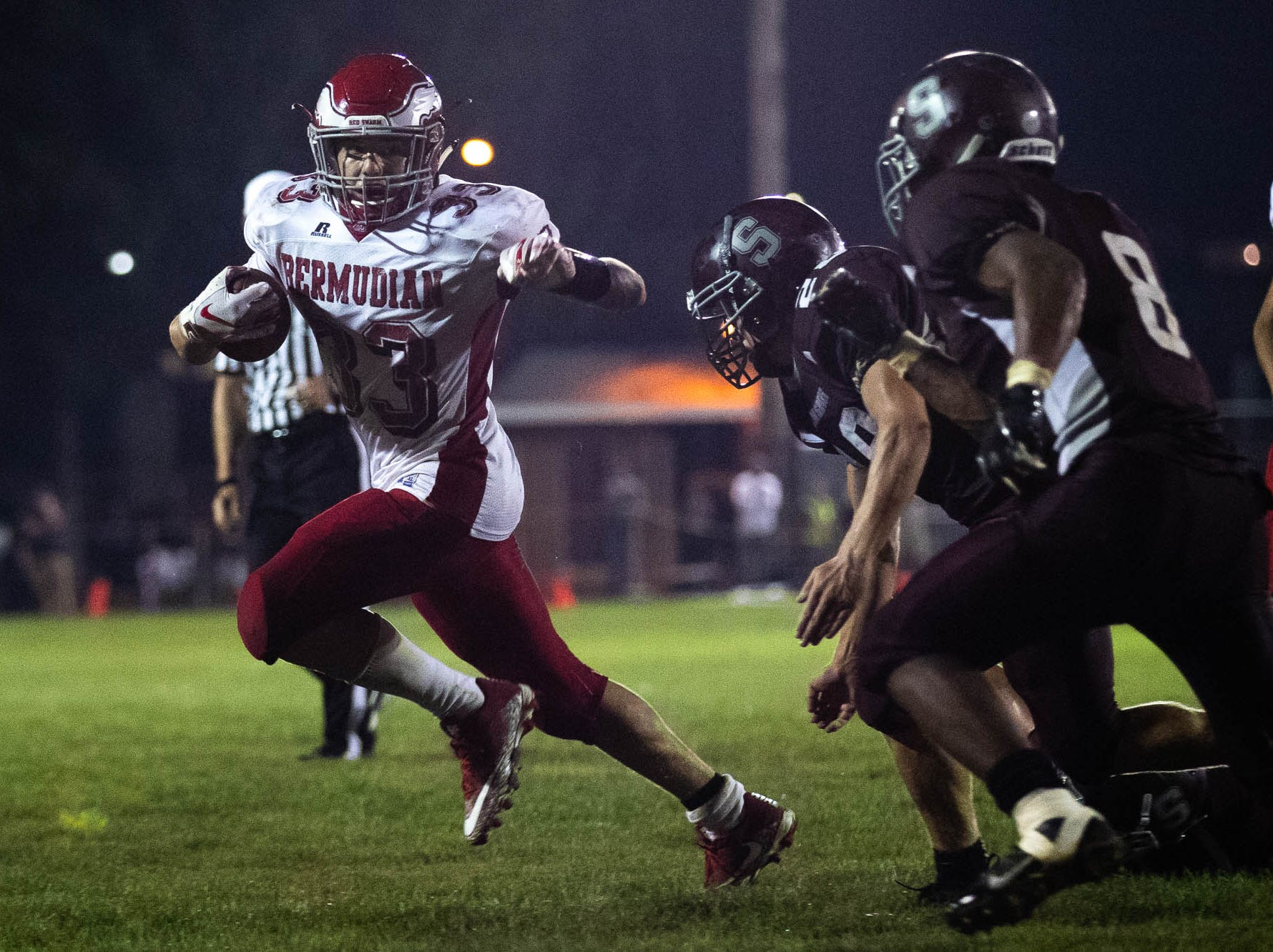 Bermudian Springs' Trace Grim (33) runs the ball during a football game between Shippensburg and Bermudian Springs, Friday, Sept. 7, 2018, at Shippensburg High School. The Shippensburg Greyhounds defeated the Bermudian Springs Eagles 31-17.