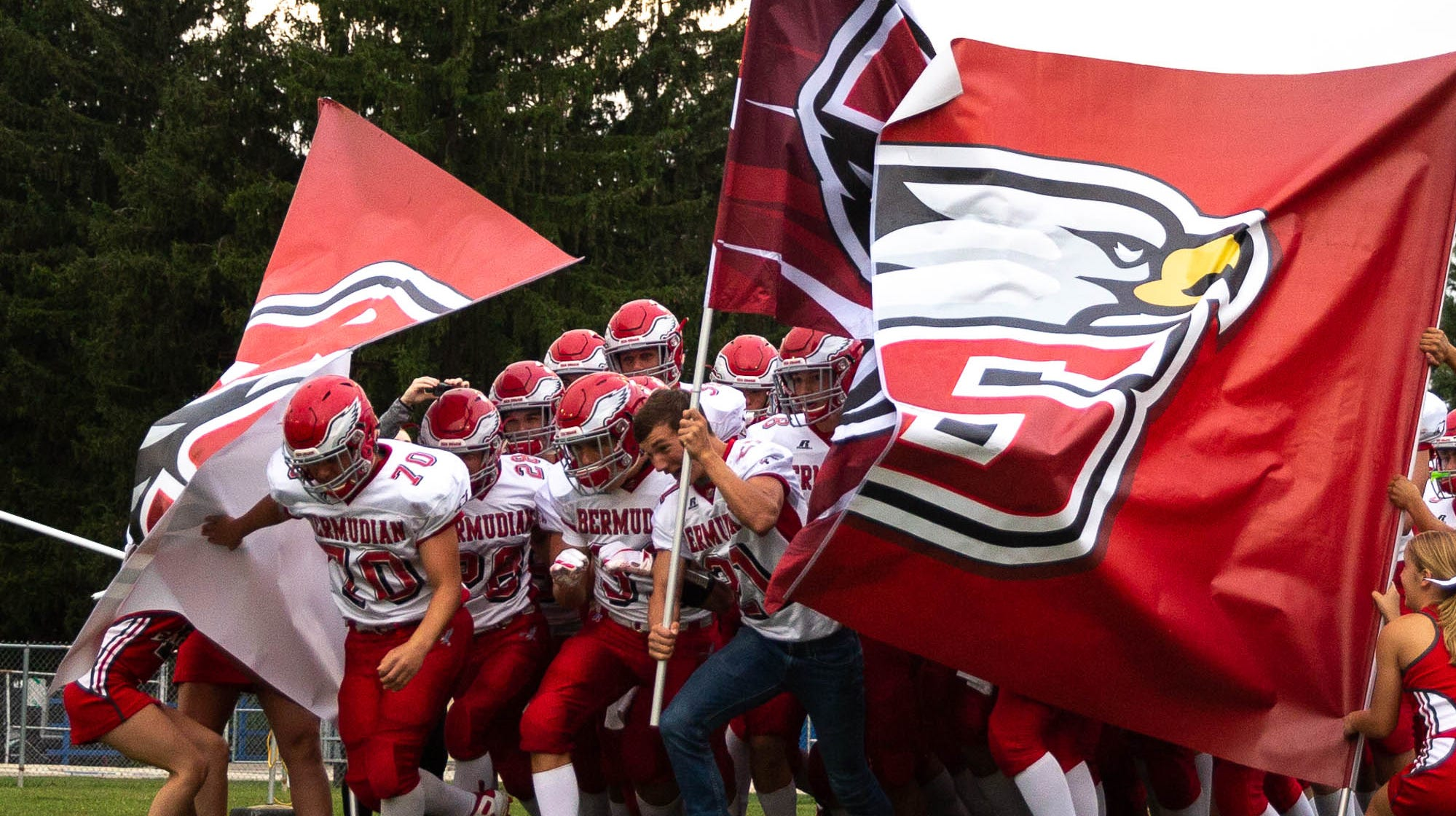 The Bermudian Springs Eagles burst onto the field before a football game between Shippensburg and Bermudian Springs, Friday, Sept. 7, 2018, at Shippensburg High School.
