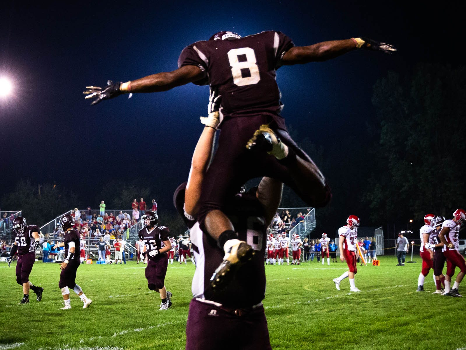 Shippensburg's Adam Houser (8) is lifted into the air by Shippensburg's Trey Lynch (66) after Houser scored a touchdown during a football game between Shippensburg and Bermudian Springs, Friday, Sept. 7, 2018, at Shippensburg High School. The Shippensburg Greyhounds defeated the Bermudian Springs Eagles 31-17.