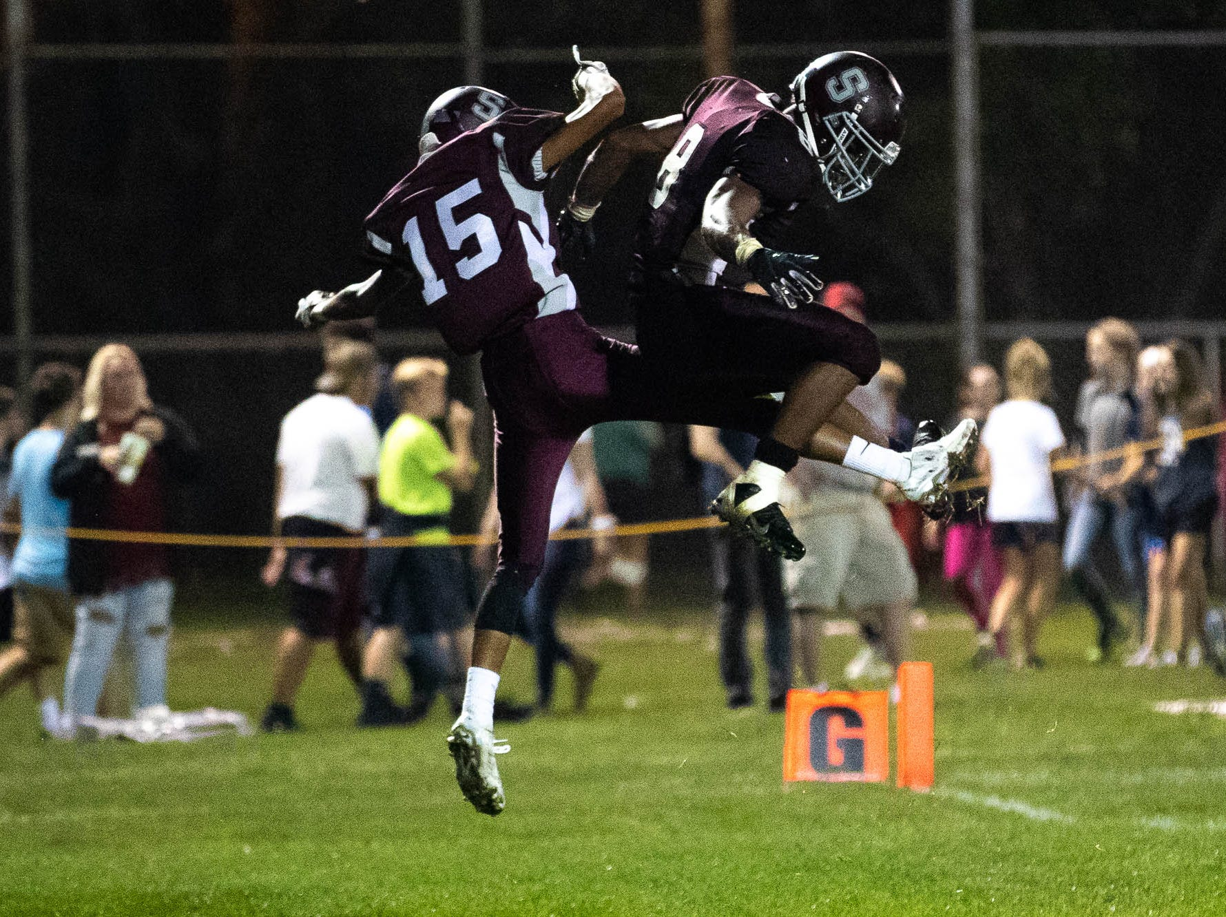 Shippensburg's Isaiah Houser (15) celebrates a touchdown with Shippensburg's Adam Houser (8) during a football game between Shippensburg and Bermudian Springs, Friday, Sept. 7, 2018, at Shippensburg High School.  Shippensburg Greyhounds defeated the Bermudian Springs Eagles 31-17.