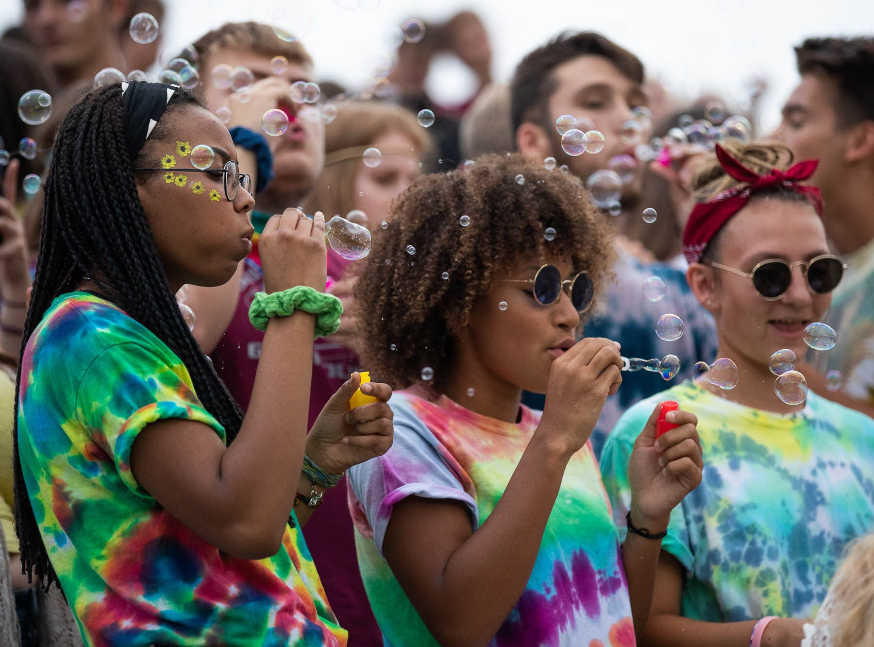 The Shippensburg student section blows bubbles before a football game between Shippensburg and Bermudian Springs, Friday, Sept. 7, 2018, at Shippensburg High School.