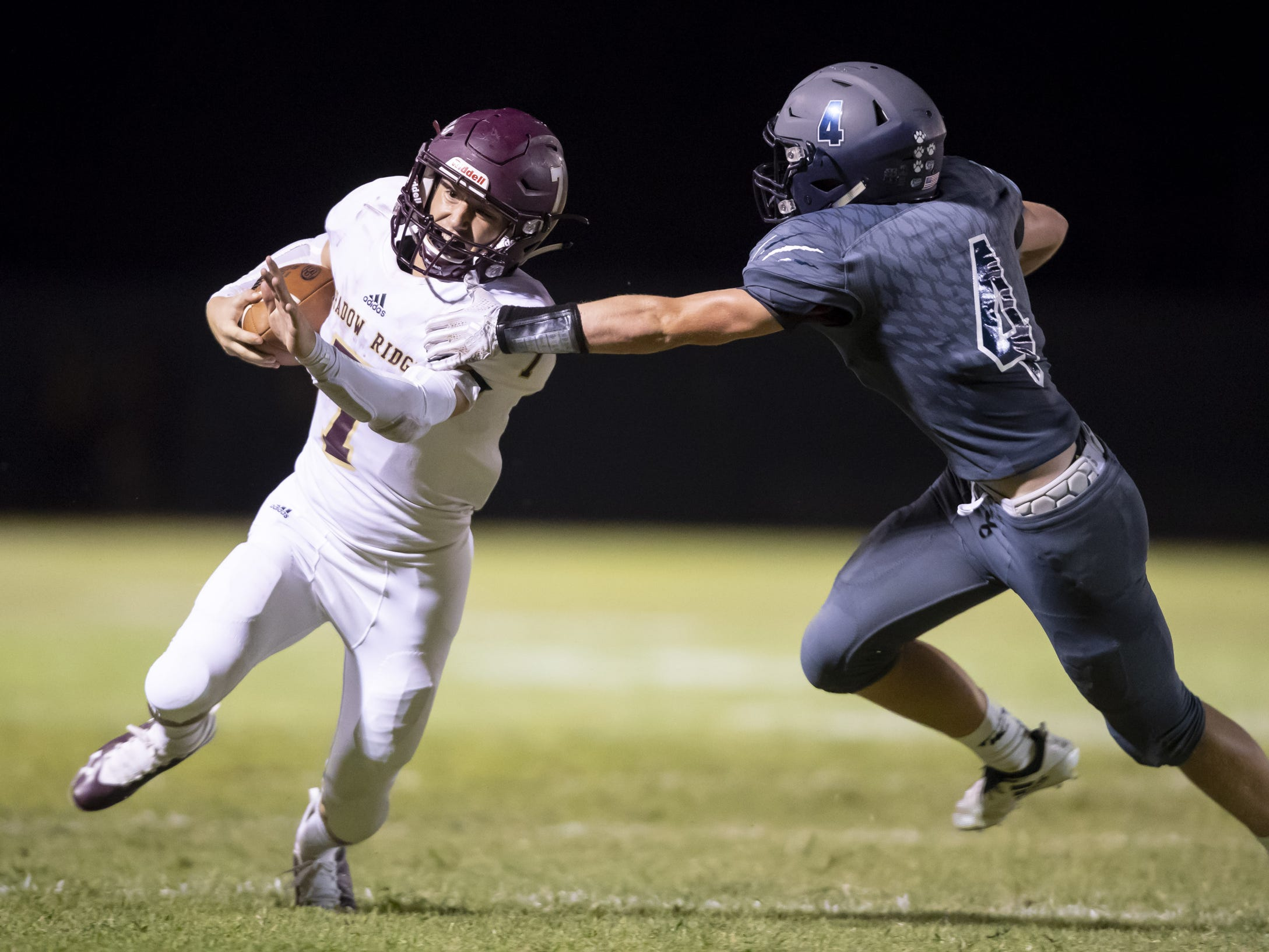Junior running back Michael Clark (7) of the Shadow Ridge Stallions runs the ball against junior defensive back Jonathan Hagestad (4) of the Willow Canyon Wildcats at Willow Canyon High School on Friday, September 7, 2018 in Surprise, Arizona. #azhsfb
