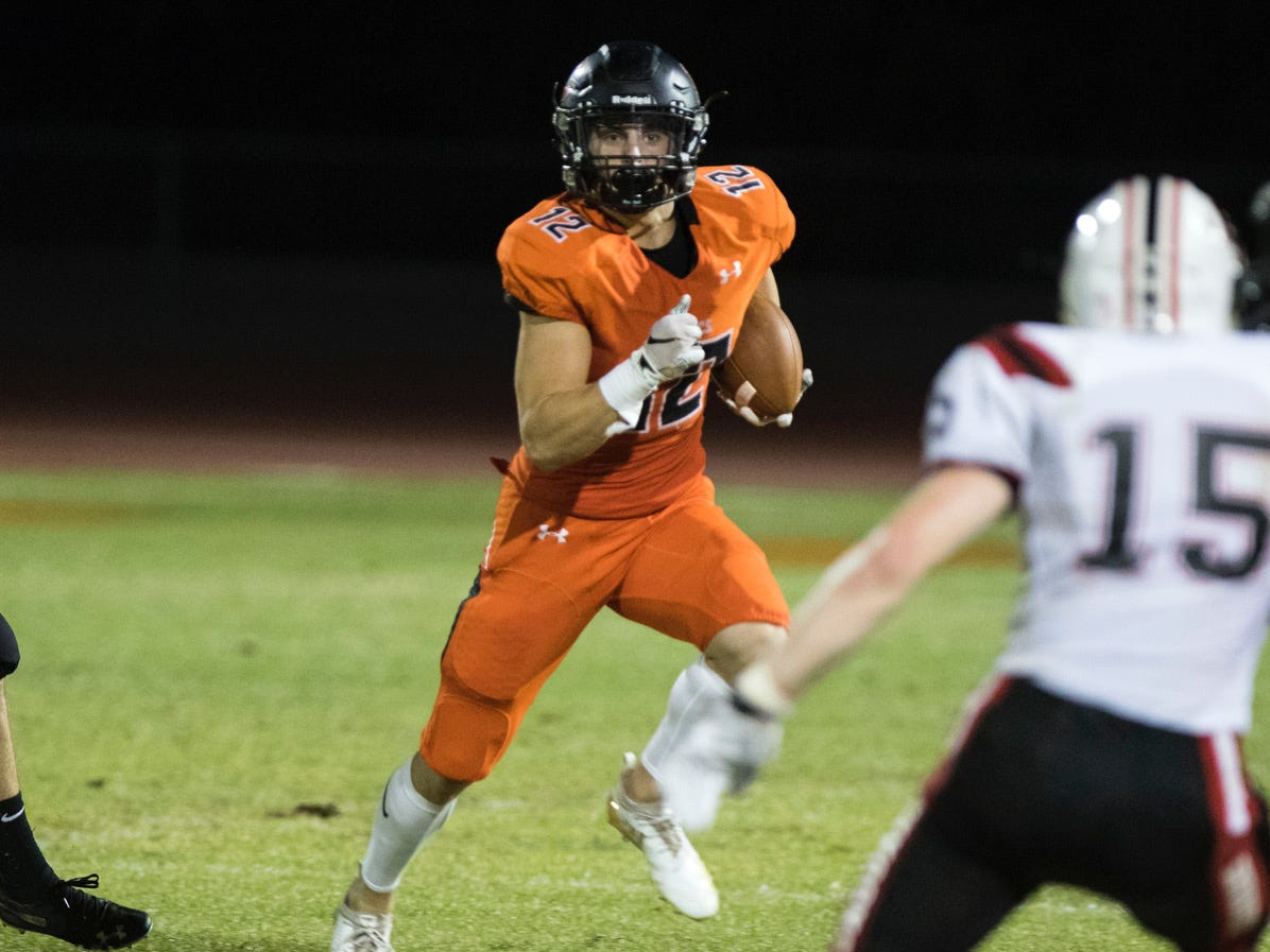 Corona del Sol's Ricky Pearsall looks for running room against Boulder Creek during their game in Tempe Friday, Sept. 7, 2018. #azhsfb