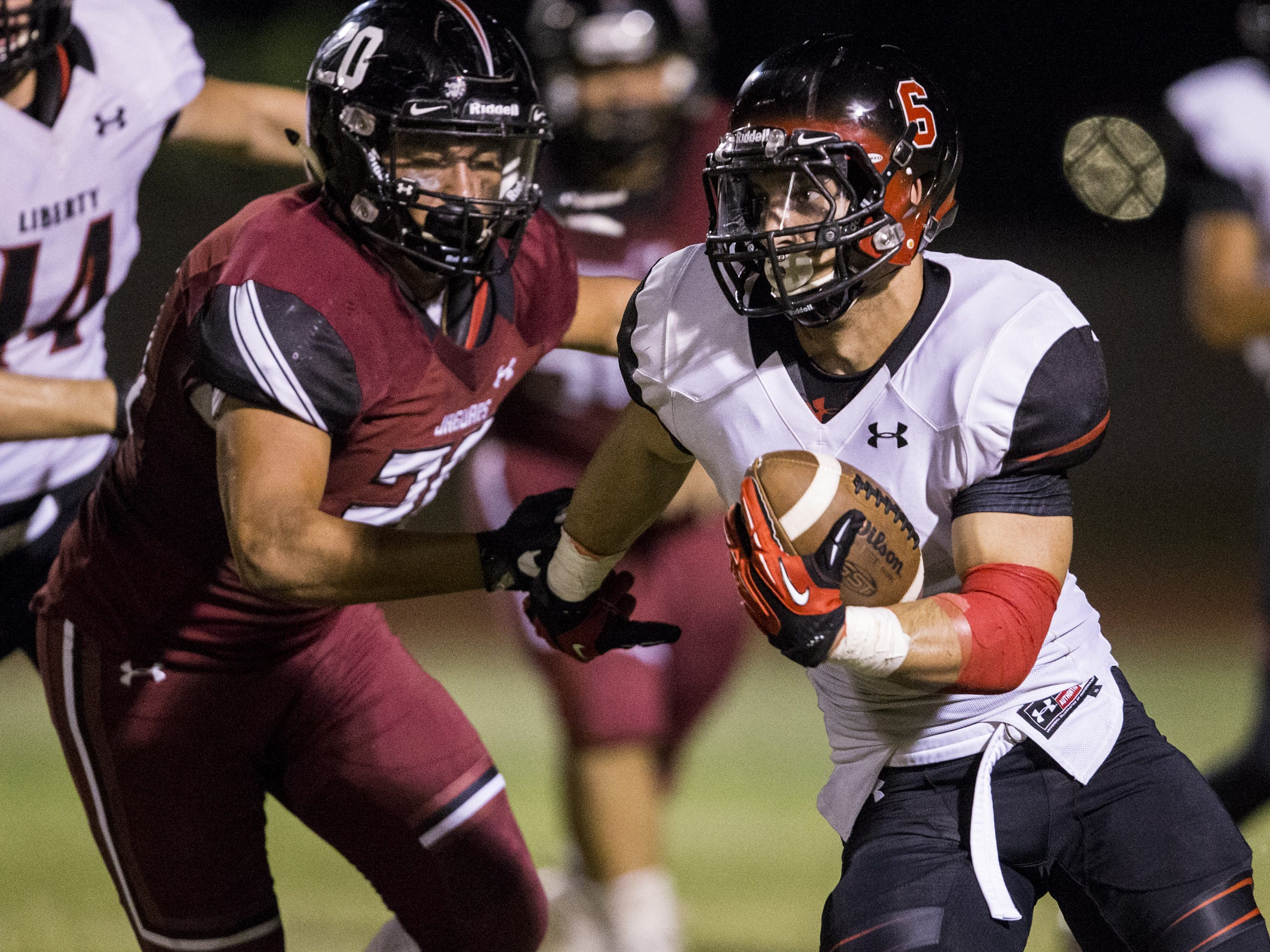 Liberty's Jett Kinsch rushes against Desert Ridge in the 2nd quarter on Friday, Sept. 7, 2018, at Desert Ridge High School in Mesa, Ariz.  #azhsfb