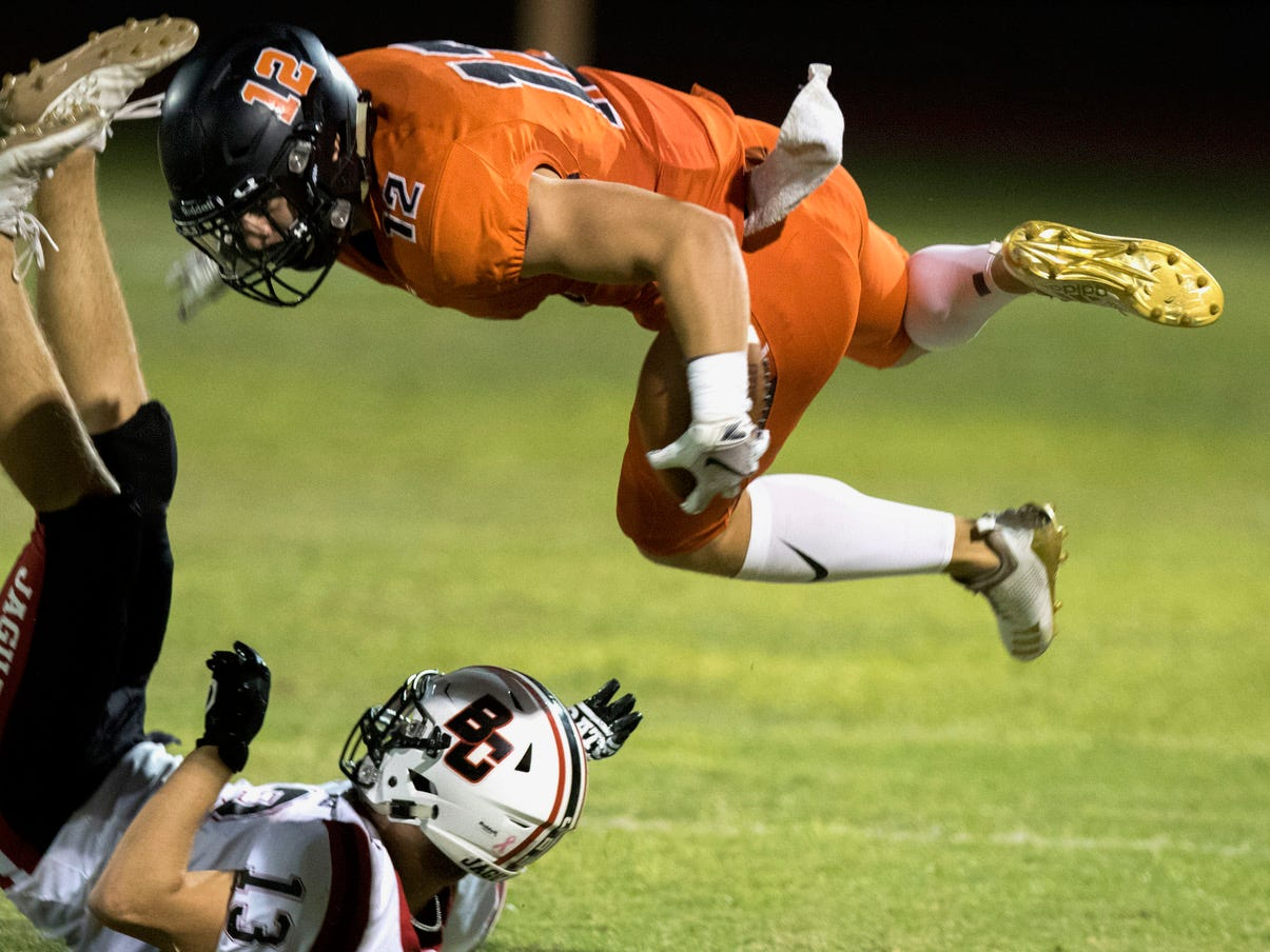 Corona del Sol's Ricky Pearsall gets upended by against Boulder Creek's Hunter Burkett during their game in Tempe Friday, Sept. 7, 2018. #azhsfb