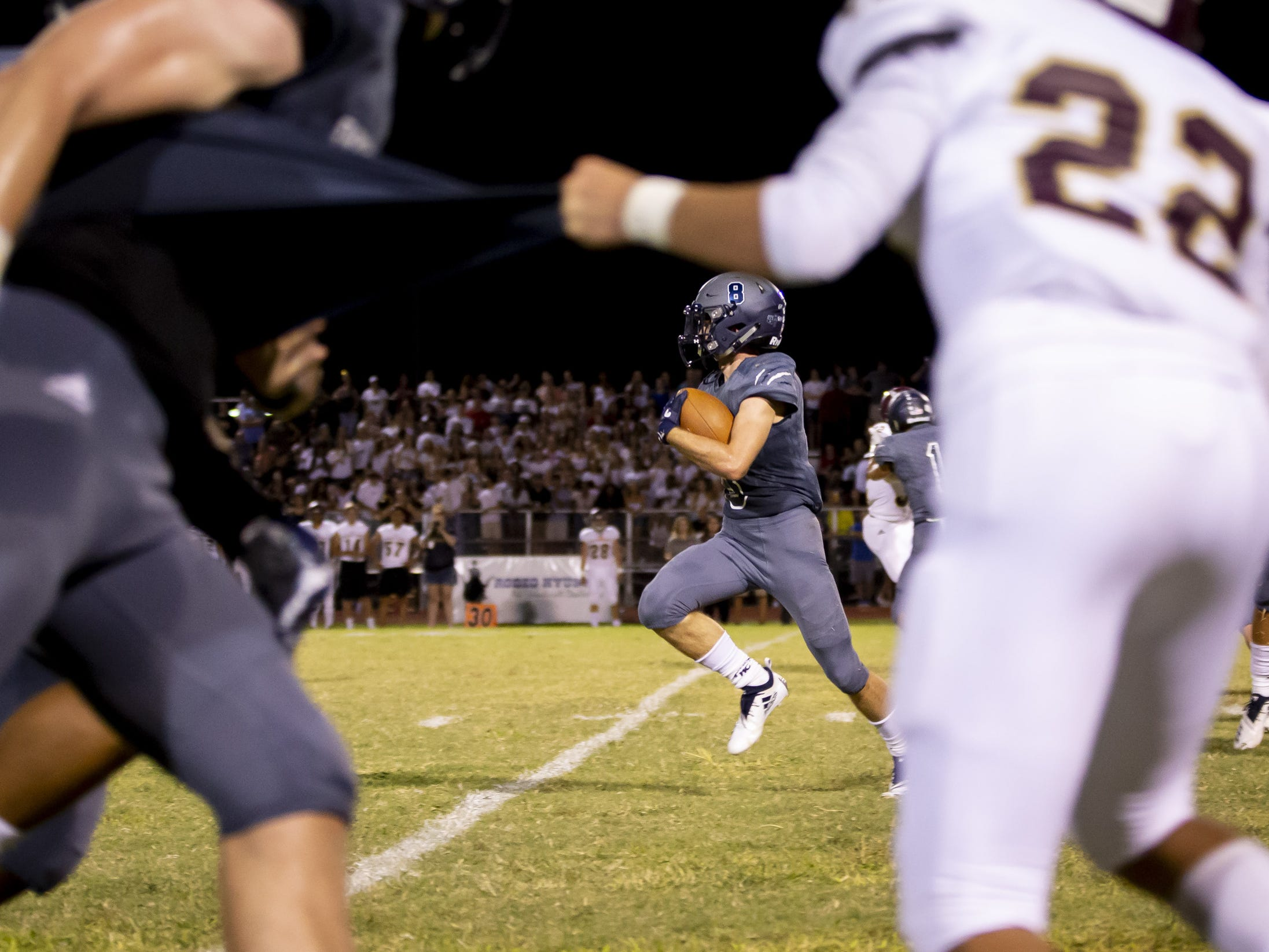 Senior running back Zachary Swinbourne (8) of the Willow Canyon Wildcats runs the ball against the Shadow Ridge Stallions at Willow Canyon High School on Friday, September 7, 2018 in Surprise, Arizona. #azhsfb