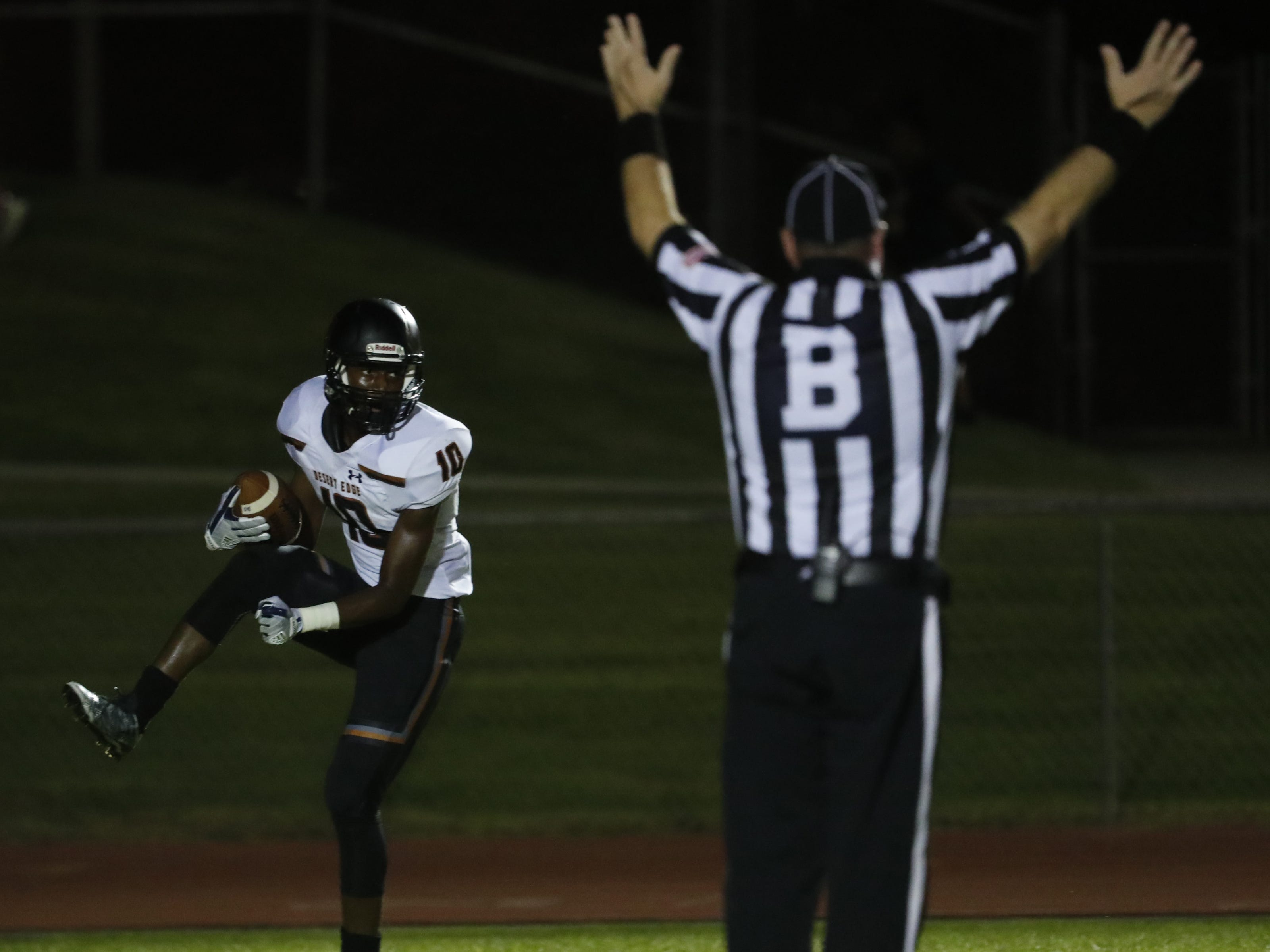Desert Edge's Jihad Marks (10) celebrates a touchdown against Millennium during a game at Millennium High School in Goodyear, Ariz. on Sept. 7, 2018.