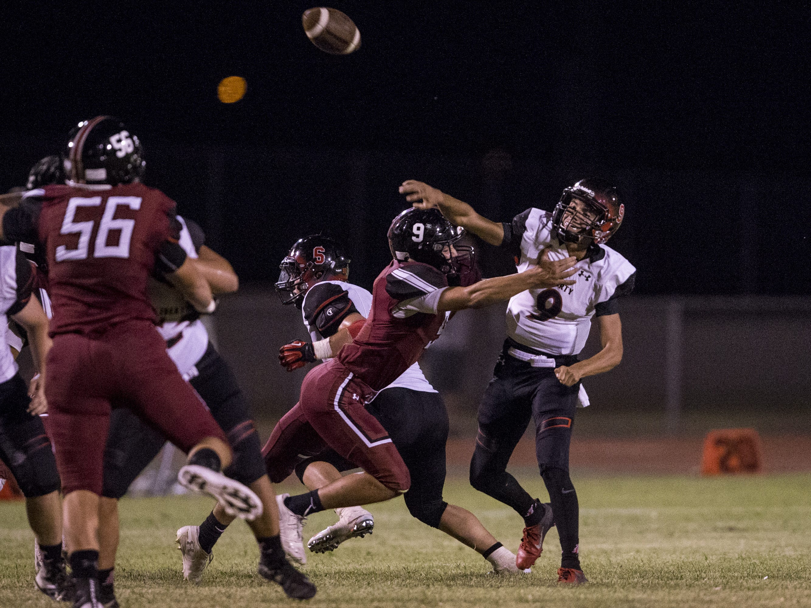 Liberty's Jonah Guevara throws against Desert Ridge in the 2nd quarter on Friday, Sept. 7, 2018, at Desert Ridge High School in Mesa, Ariz.  #azhsfb