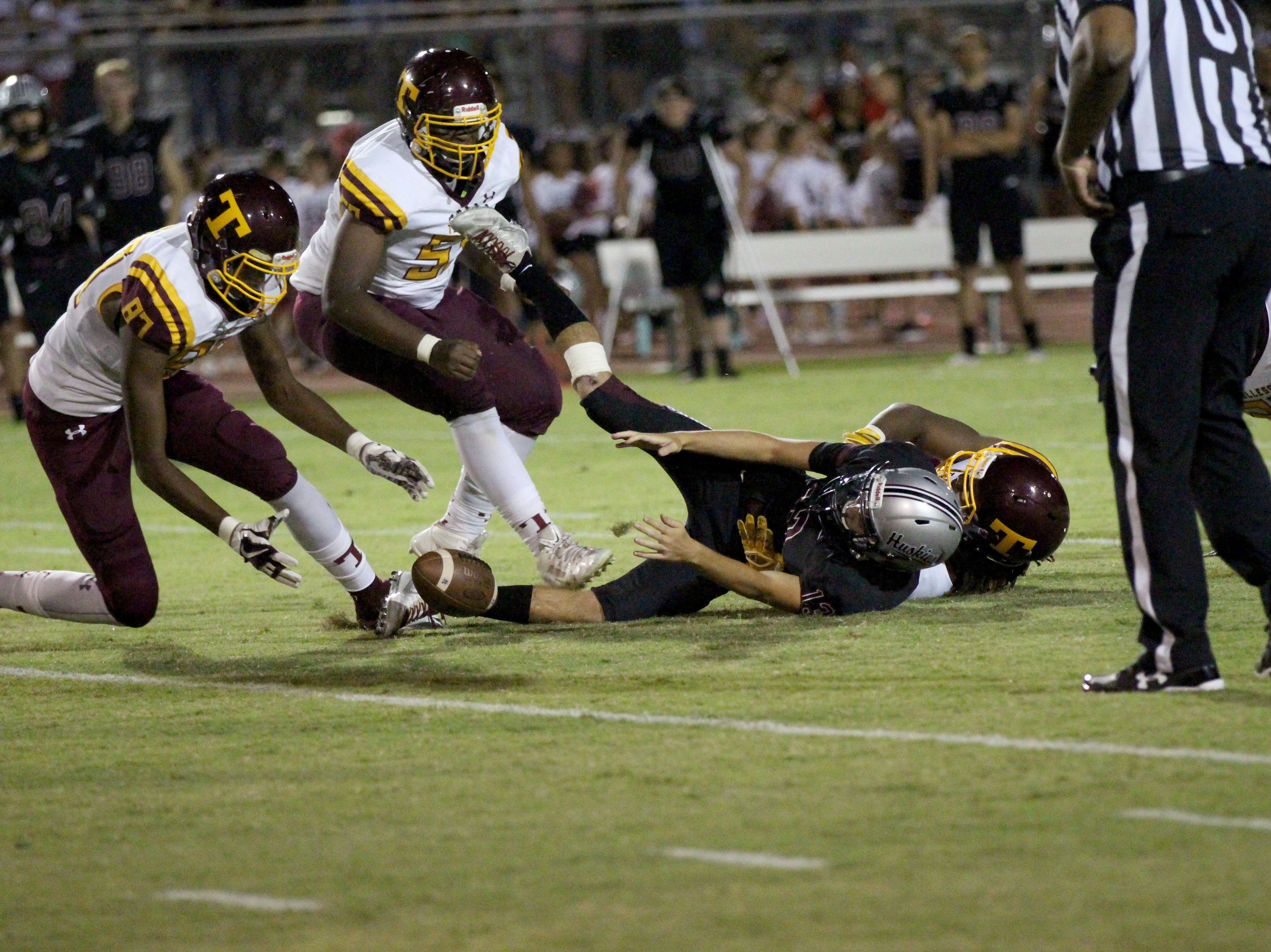 Tolleson's defense forces and recovers a fumble against Hamilton on Friday night in Chandler, Ariz. Sept. 7, 2018.