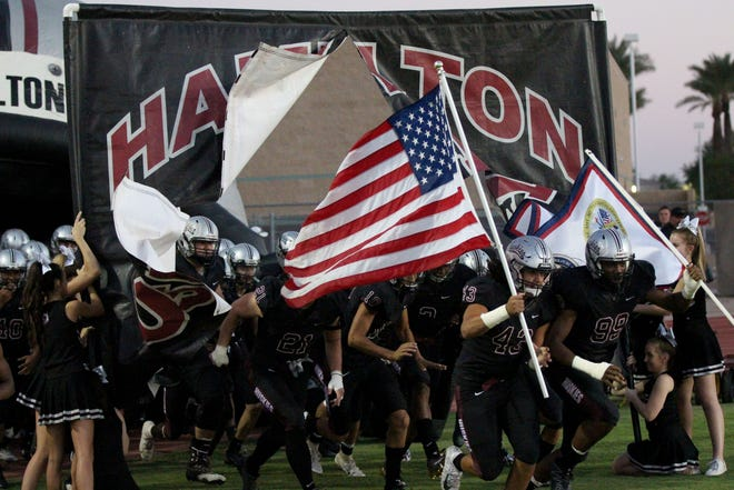 Hamilton takes the field before its game against Tolleson on Friday night in Chandler, Ariz. Sept. 7, 2018.