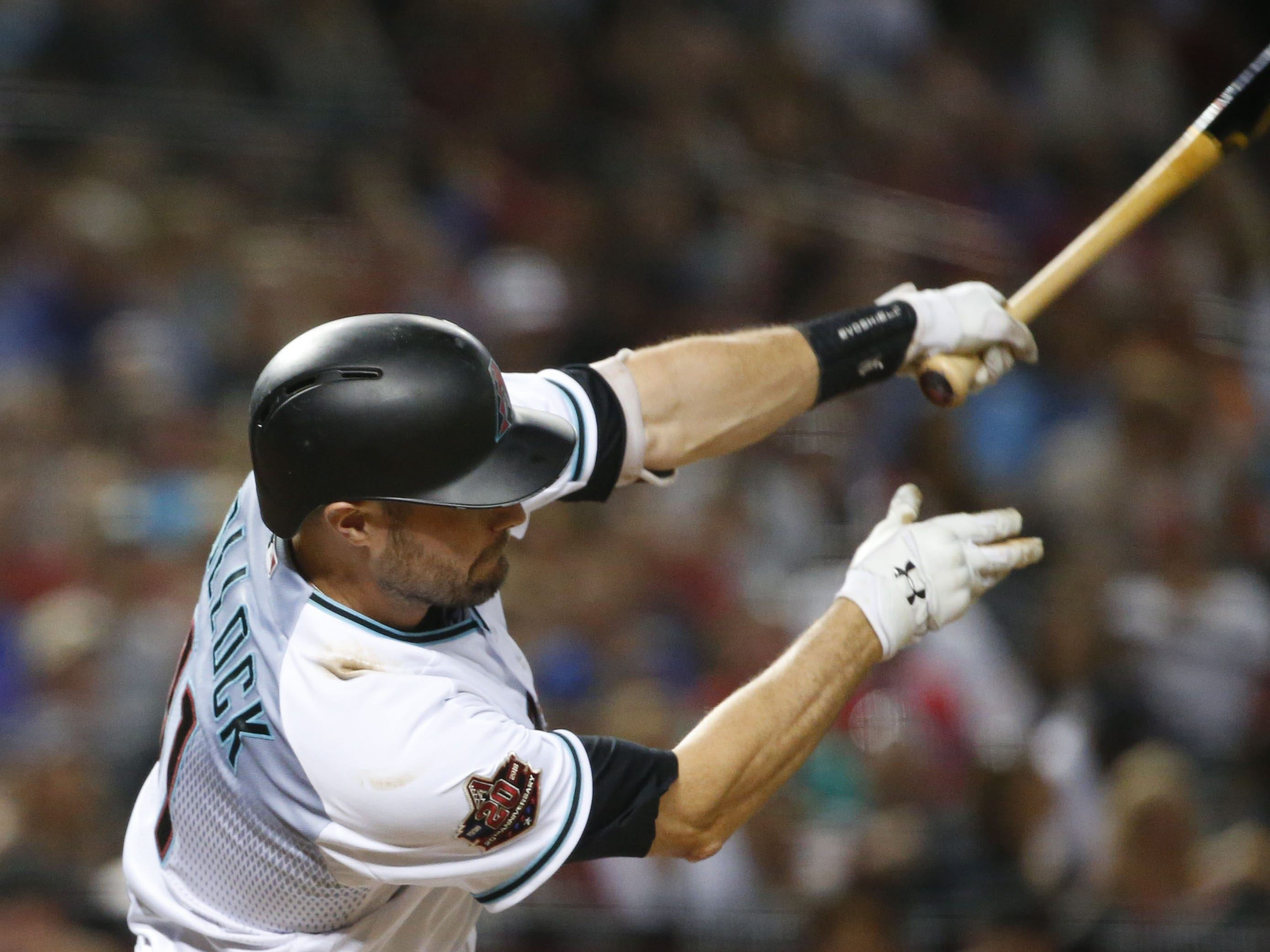 Arizona Diamondbacks center fielder A.J. Pollock (11) foul tips a ball during a MLB game against the Atlanta Braves at Chase Field in Phoenix on September 7, 2018.