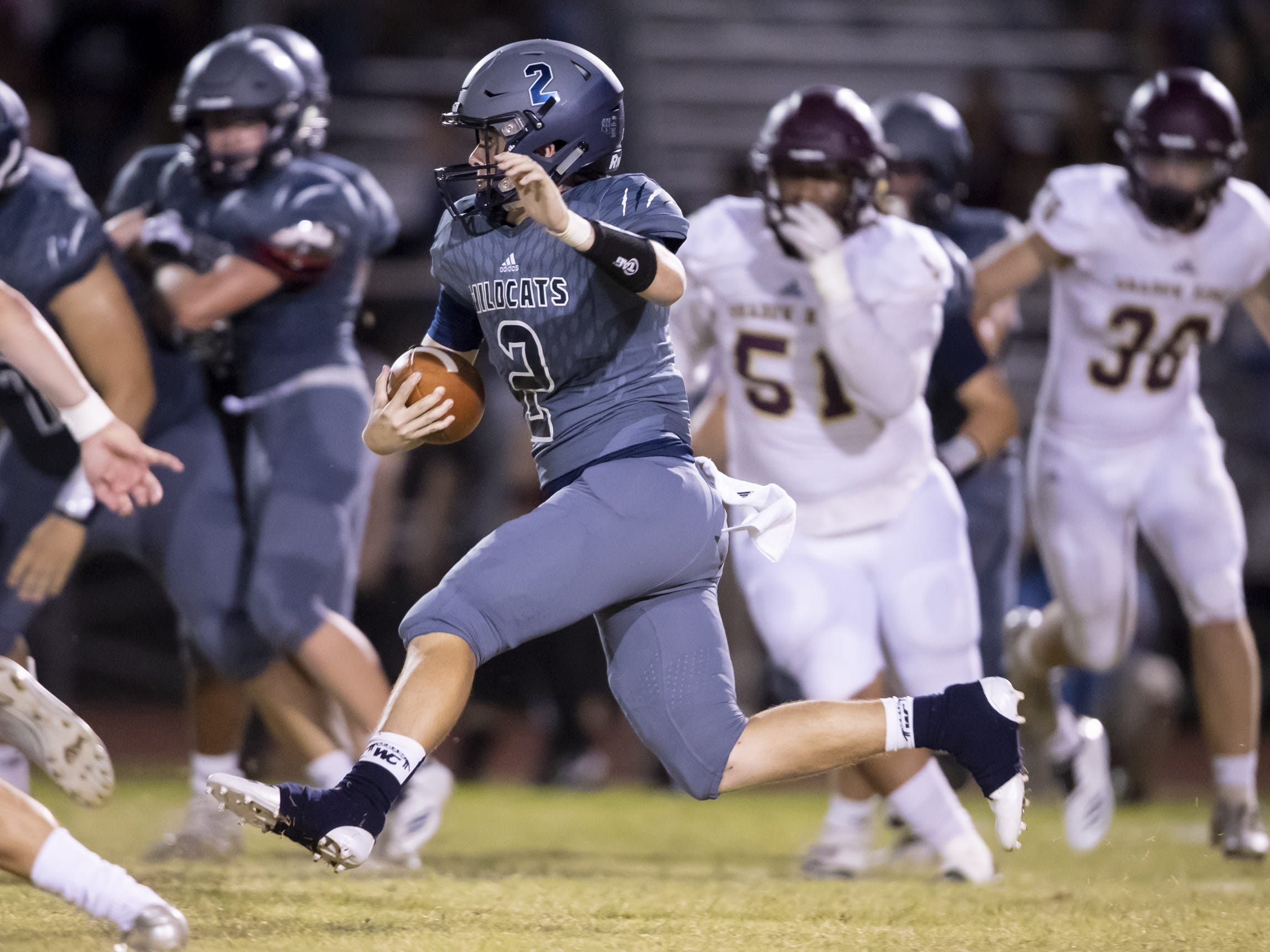 Senior quarterback Brendan Haynes (2) of the Willow Canyon Wildcats runs the ball against the Shadow Ridge Stallions at Willow Canyon High School on Friday, September 7, 2018 in Surprise, Arizona. #azhsfb