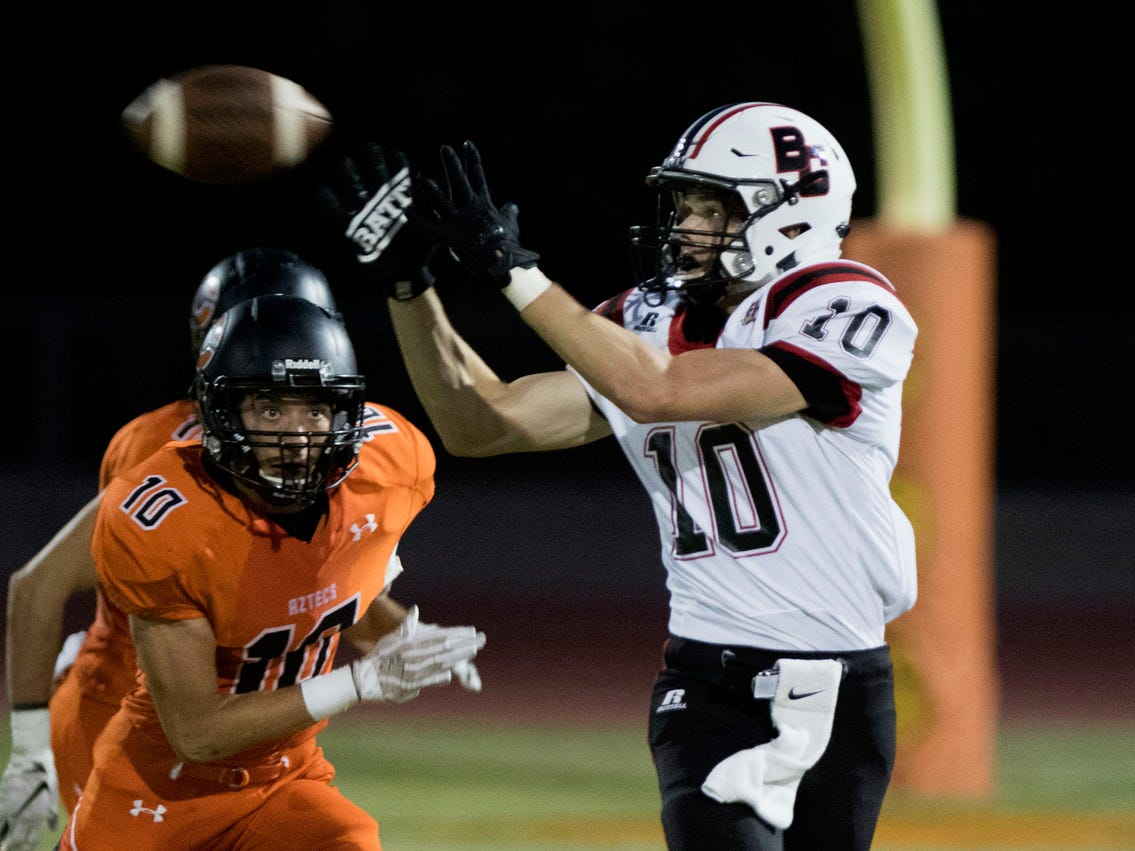Boulder Creek's Hendrix Johnson eyes the ball as Corona Del Sol's Emilio Echerivel eyes him during their game in Tempe Friday, Sept. 7, 2018. #azhsfb