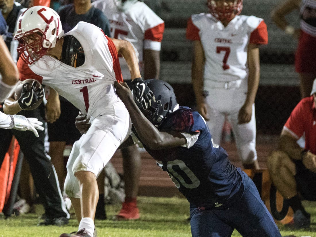 Central's Eric Lara gets pulled down from behind by McClintock's Armani Williams during their game in Tempe Friday, Sept. 7, 2018. #azhsfb