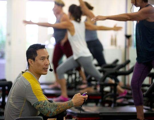 Trainer Adam Maielua teaches a hardcore Pilates class using the Lagree Method at a The Body Lab, in Phoenix on September 6, 2018.