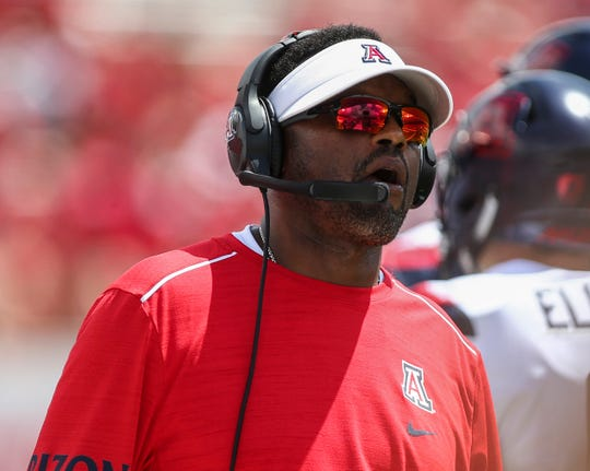 Arizona Wildcats head coach Kevin Sumlin looks on from the sideline during the third quarter against the Houston Cougars at TDECU Stadium.