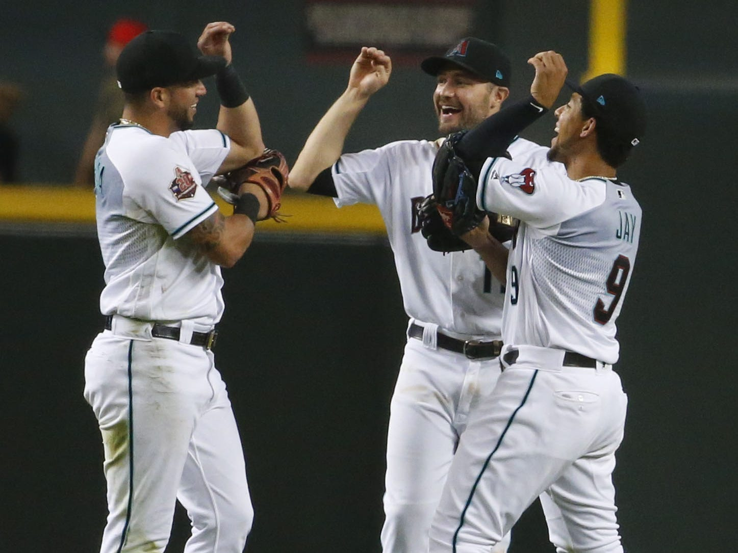 Arizona Diamondbacks outfielders celebrate a win during a MLB game against Atlanta Braves at Chase Field in Phoenix on September 7, 2018.