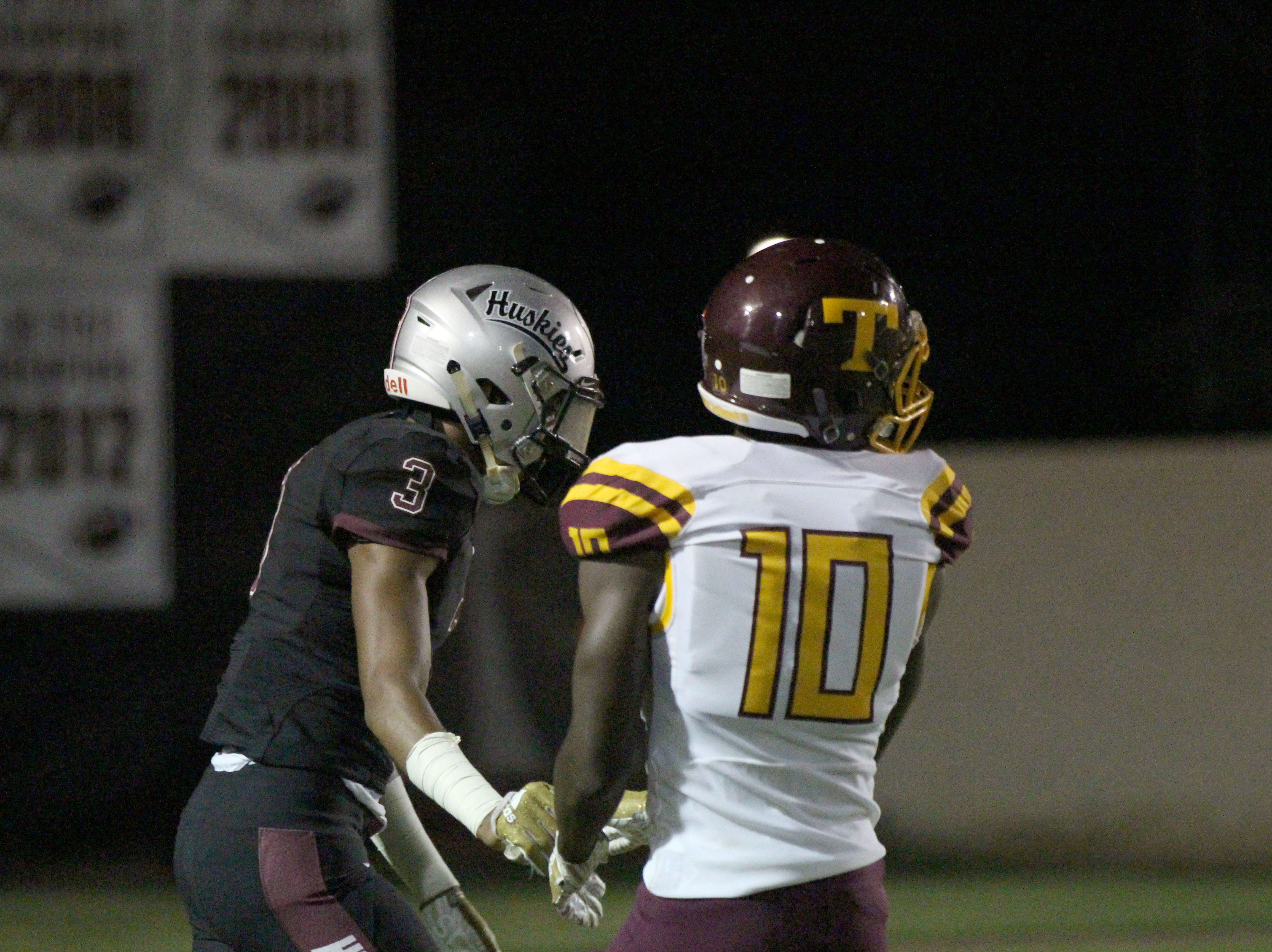 Hamilton's Javin Wright (3) shakes Tolleson's Andre Johnson (10) on Friday night in Chandler, Ariz. Sept. 7, 2018.