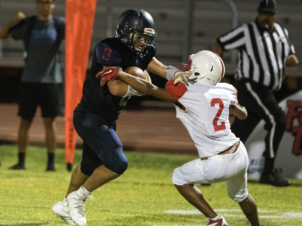 McClintock's David Cisneros tries to slip past Central's Javon Keene during their game in Tempe Friday, Sept. 7, 2018. #azhsfb