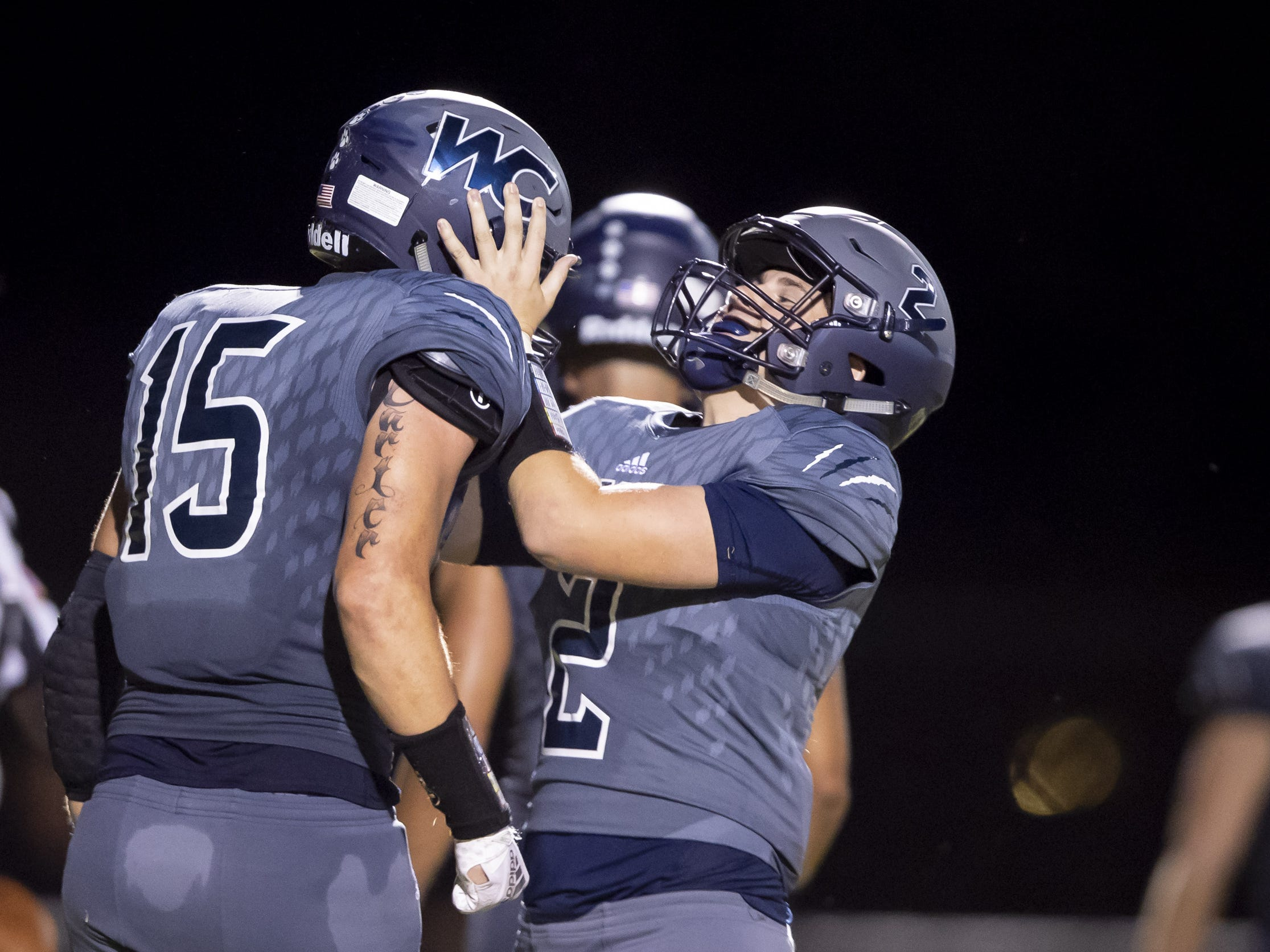 Senior wide receiver Ben Carter (15) and senior quarterback Brendan Haynes (2) of the Willow Canyon Wildcats celebrate a touchdown against the Shadow Ridge Stallions at Willow Canyon High School on Friday, September 7, 2018 in Surprise, Arizona. #azhsfb