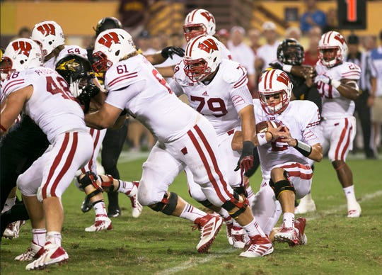 Wisconsin quarterback Joel Stave takes a knee after a 2-yard rushing loss against Arizona State at Sun Devil Stadium on Saturday, Sep. 14, 2013 in Tempe, AZ. The game ended on this play, as ASU defeated Wisconsin 32-30.