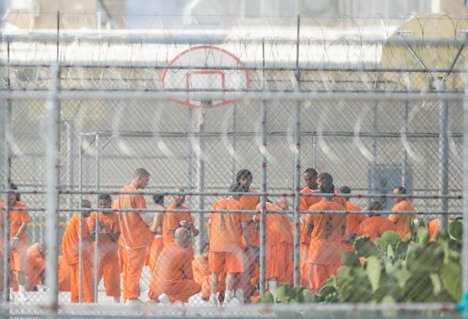 Inmates are seen at Arizona State Prison Complex-Kingman in Golden Valley, Ariz., which is privately managed by GEO Group, in this 2018 file photo.