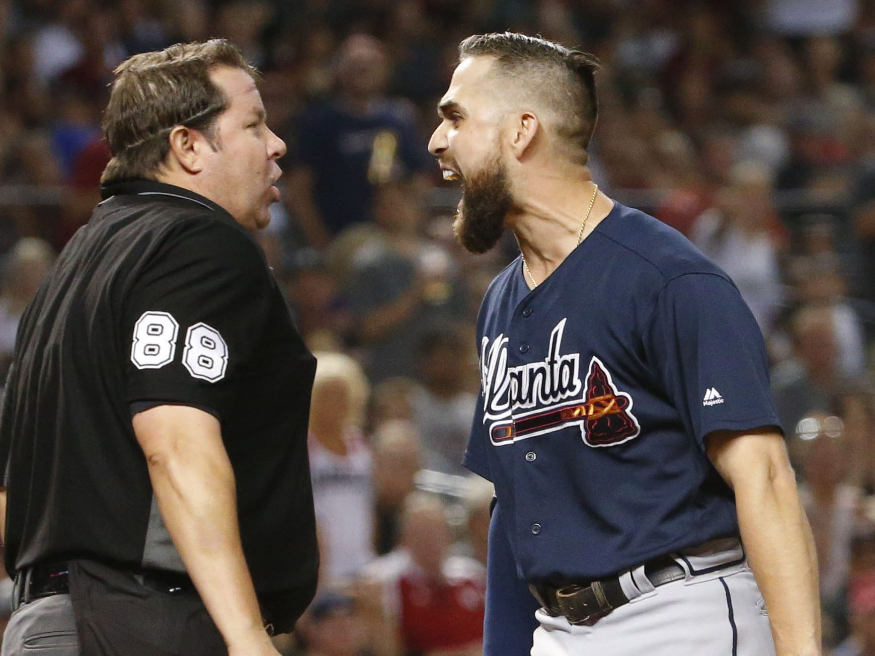 Umpire Doug Eddings (88) tosses Atlanta Braves center fielder Ender Inciarte (11) for arguing balls and strikes during a MLB game against the Arizona Diamondbacks at Chase Field in Phoenix on September 7, 2018.