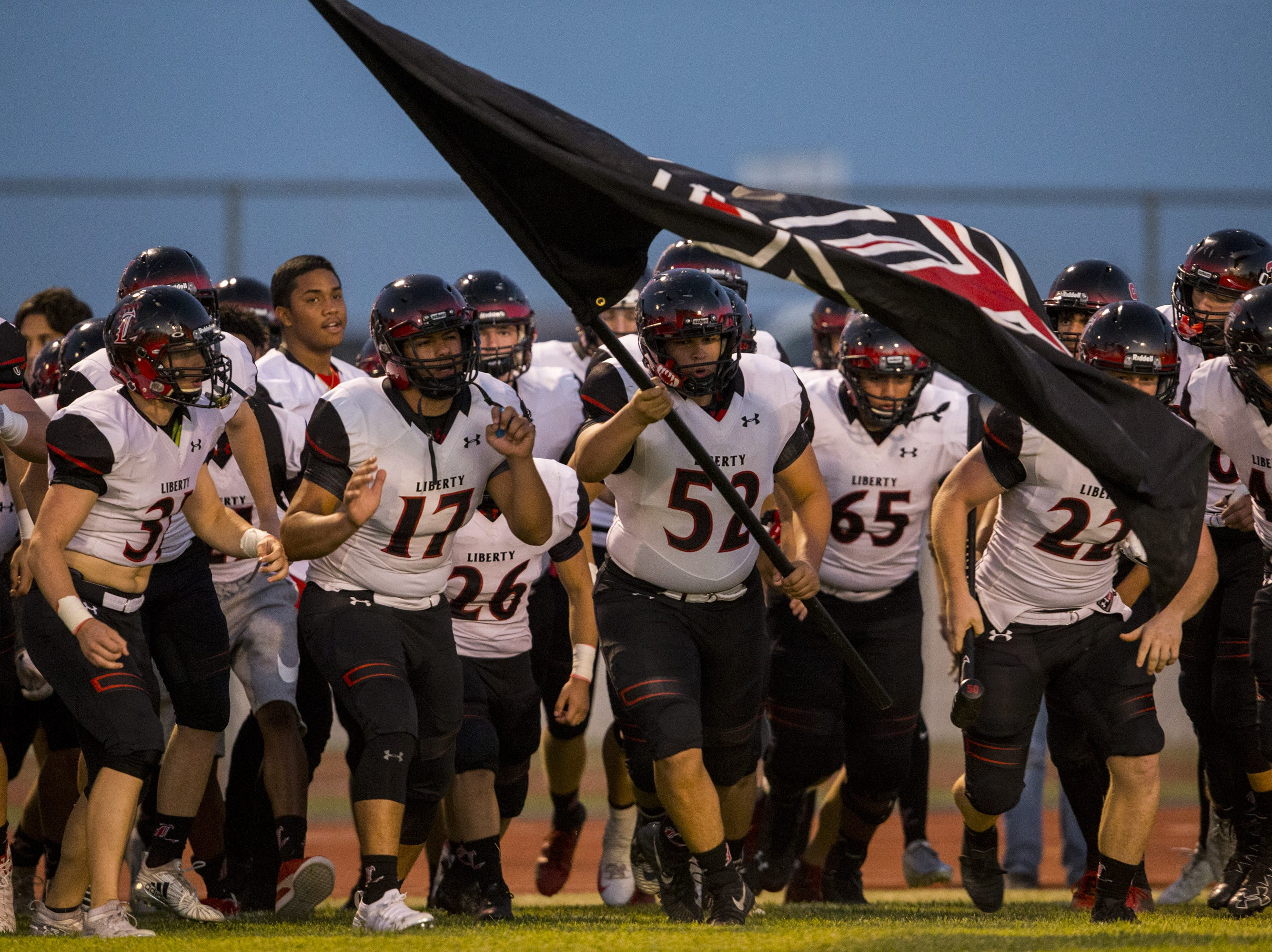 Liberty takes the field before the game against Desert Ridge on Friday, Sept. 7, 2018, at Desert Ridge High School in Mesa, Ariz.  #azhsfb