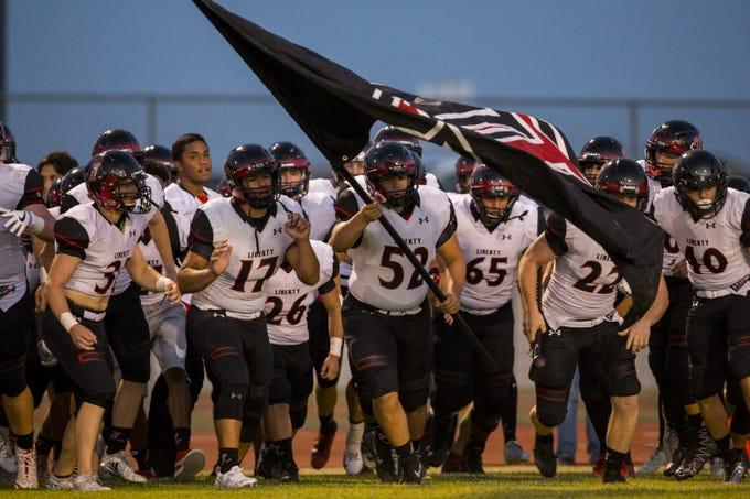 Liberty takes the field before the game against Desert Ridge on Friday, Sept. 7, 2018, at Desert Ridge High School in Mesa, Ariz.  #azhsfb