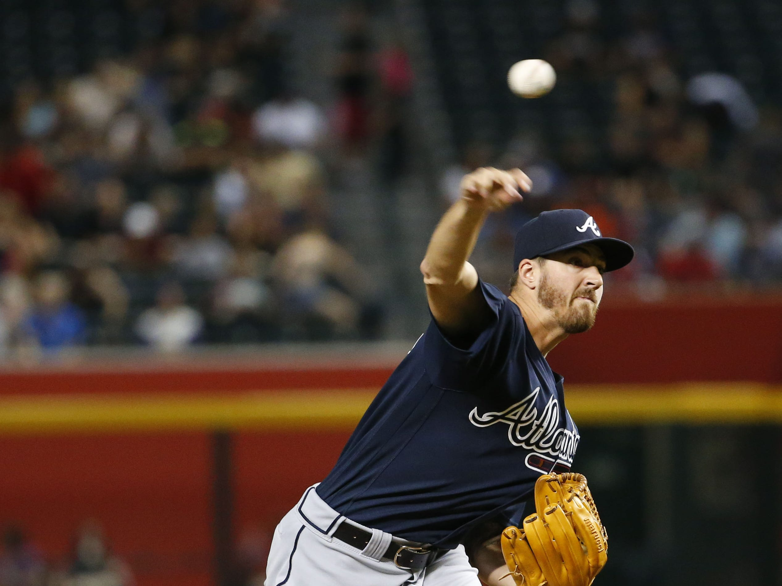 Atlanta Braves starting pitcher Kevin Gausman (45) throws during a MLB game against Arizona Diamondbacks at Chase Field in Phoenix on September 7, 2018.