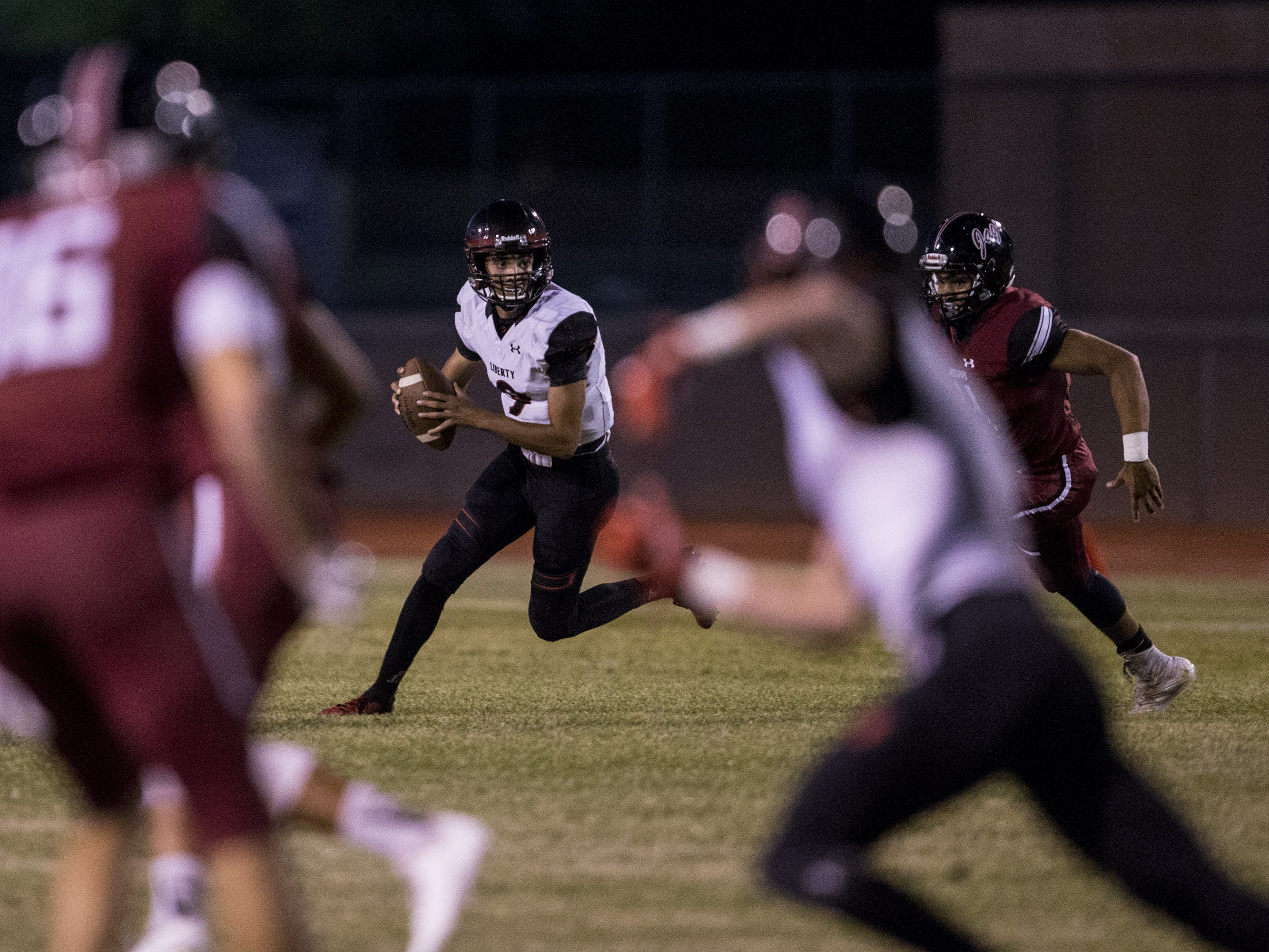 Liberty's Jonah Guevara looks to pass against Desert Ridge in the 1st quarter on Friday, Sept. 7, 2018, at Desert Ridge High School in Mesa, Ariz.  #azhsfb