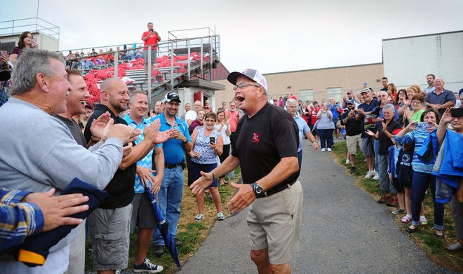 Annville-Cleona assistant coach Frank Hetrick greets former players and fellow coaches prior to a ceremony honoring his 50 years in coaching on Friday night.
