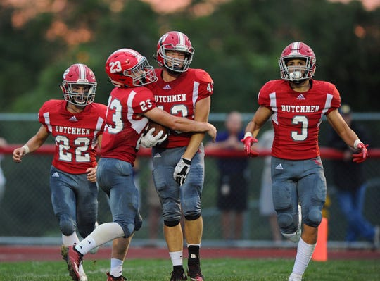 Annville-Cleona's Trevor Porche (43) gets a hug from his teammate Evan Heilman (23) after he scored A-C's second TD of the game in a Week 3 win over Ephrata. Annville-Cleona hosts Lancaster Catholic in a Section 3 first place showdown on Friday night.