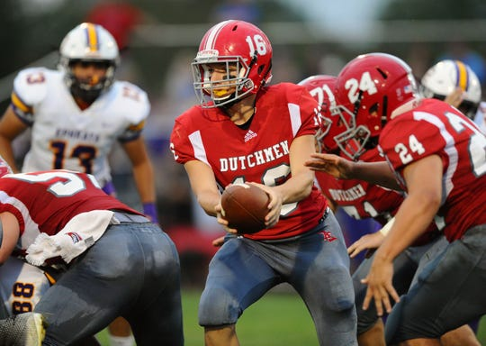 A-C QB Jeremy Bours Jr.(16) hands the ball to RB Caleb Turner(24) during first quarter action on Friday night. Bours' 38-yard TD pass to Jalen Price as time expired gave A-C a 41-35 win.